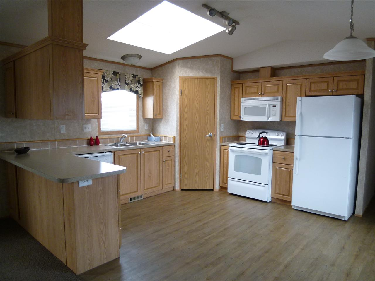 10 Min to Wabamun Lake, 30 min from Spruce Grove and 55 min West of Edmonton.  A Great Floor Plan with 3 Bedrooms and 2 baths, Vaulted Living Room Ceiling.  Large Living Room and Bright Kitchen with Skylight, Plenty of Cupboards and Convenient Pantry. Sleep well in this Spacious Master Bedroom with 4 pce Ensuite and Walk in Closet.  This home is in Mint Condition. Steps and Skirting installed in 2018. Located on a Quiet Street close to the Park Reserve and 1 block from the Arena.  A very Affordable and Spacious Home in a Resort Like Community with Lakes, River, Golfing, Fishing, Tubing, and Walking Trails all here to enjoy! The lot is leased at $470 per month which includes Water, Sewer, Garbage and Mobile Taxes to the County.  Will consider a truck in trade for down payment.