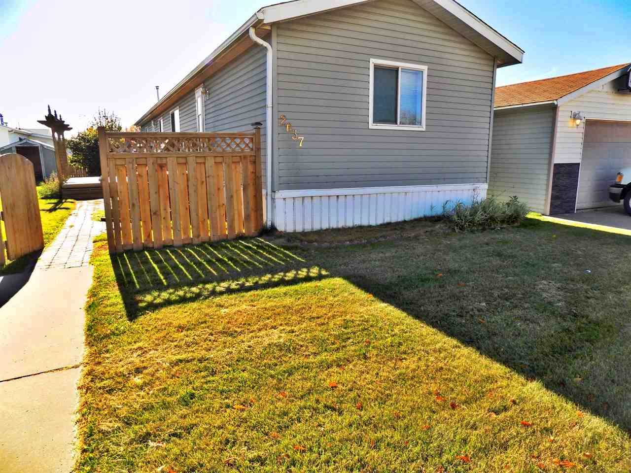 This is a great opportunity in the community of Westview village, located close to Winterburn Rd and 107 ave exclusive mobile home community. This mobile home is located on a very quiet road, it is spacious and comes with ample living space! This home has 3 large bedrooms and comes with 2 parking stalls. Has a very large living room with laminate flooring and a cozy centre fireplace. A good size kitchen comes with appliances, lots of cabinetry, 2 sinks with lots of counter top space, adjoining large dining room. The large master bedroom comes with a walk-in closet and 4 p/c ensuite bathroom with soaker tub. There are an additional 2 good sized bedrooms accompany this home all on one level. The large yard comes with a spacious deck to enjoy those long hot summers. This home is close to all amenities including shopping, restaurants and highways.