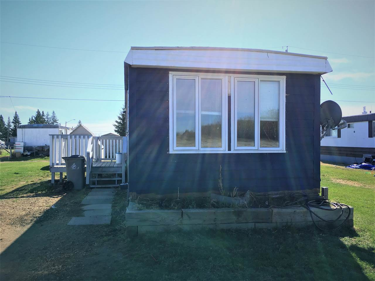 Great investment opportunity or starter home. Nestled in the quiet community of Clyde over looking a field leaves you feeling like it's country living. This 672 sqft home has two nice sized bedrooms, and one 4 piece bath. All newer windows except for two, new fridge, toilet and newer HWT as well. The kitchen has plenty of storage space as well as some added, hidden pantry shelving. Laminate and linoleum throughout. Outside you will find a 8 x 10 deck with new railing, an 8 x 8 shed and a small fire pit for those evening get togethers. Lot rent is $275. Utilities are not included in lot rent.
