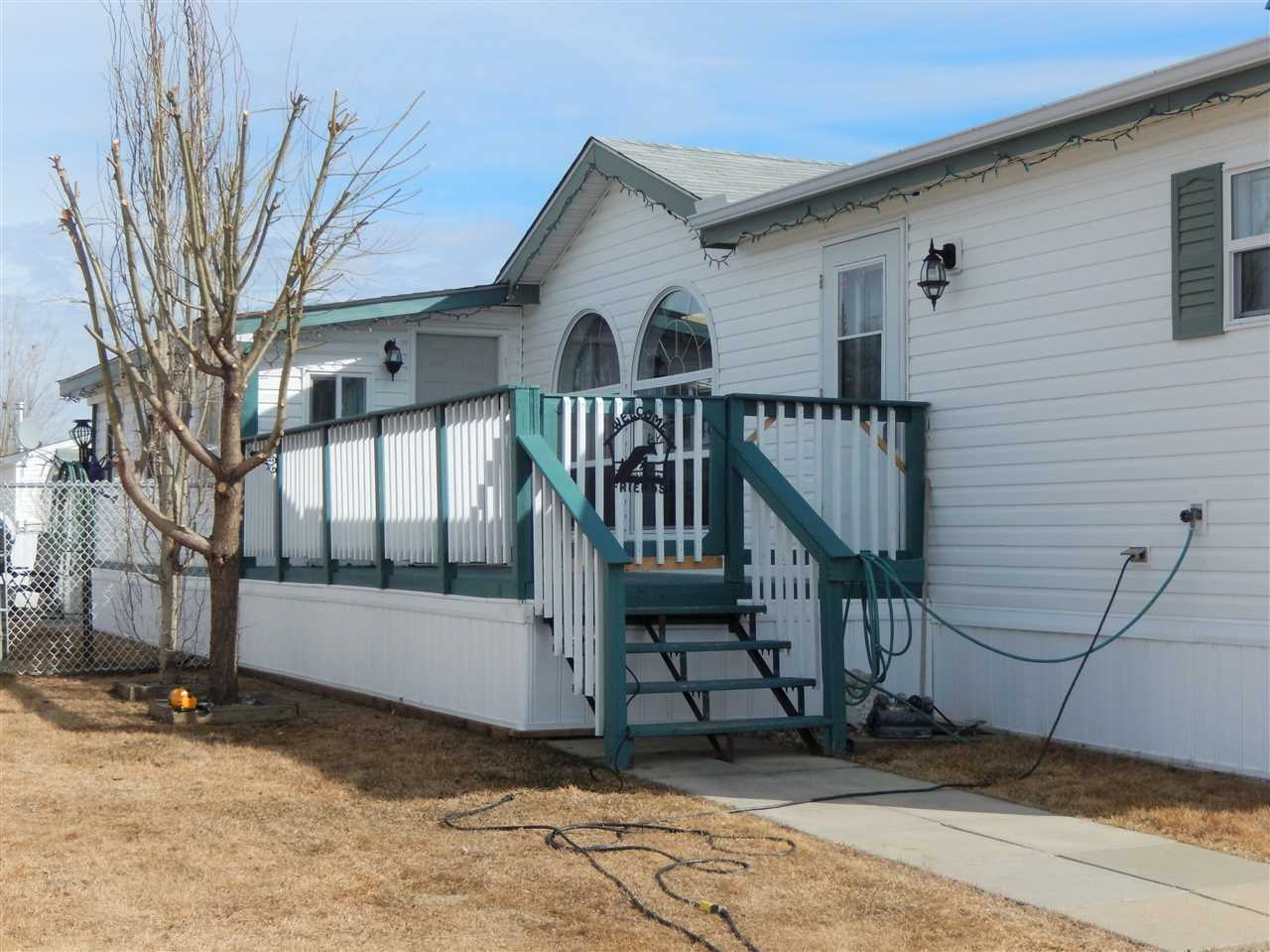 ORIGINAL OWNER! This well cared for home has much to offer with its 3 BEDRS, 2 BATHS & a LARGE ADDITION which is insulated & wired (no heat). It has 2 entrances - one at the front & one at the back (plus pet doors).  YARD is totally FENCED & there are 3 SHEDS (2 are wired- 10x16 ft, 8x12 ft, 3x6 ft.) Enjoy the SOUTHWEST FACING DECK. The living rm has LAMINATE, beautiful BIG WINDOWS...there is a DOUBLE SKYLIGHT in kitchen, plenty of counterspace, BRAND NEW DISHWASHER & a spacious dining area. The LARGE LAUNDRY RM has plenty of storage & freezer rm. Sitting at the back of home, the master has a large ENSUITE with JETTED TUB, plus WALK-IN CLOSET. There are 2 other bedrs & main bath at the front of the home.  Meridian Meadows is a wonderful community to live in and is very well managed.  Lot rent is only $375 /month.