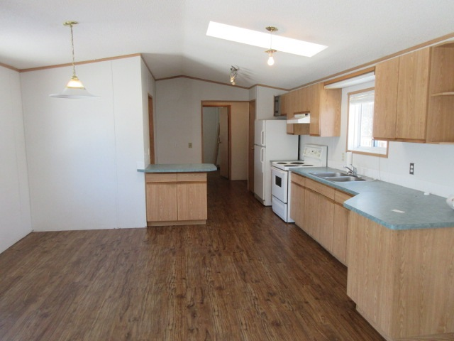 Welcome to Westview Village! This mobile home is located in one of the best mobile home parks in and around Edmonton. With 3 bedrooms, 2 bathooms and vaulted ceilings in the living room, this is a great place to call home!
