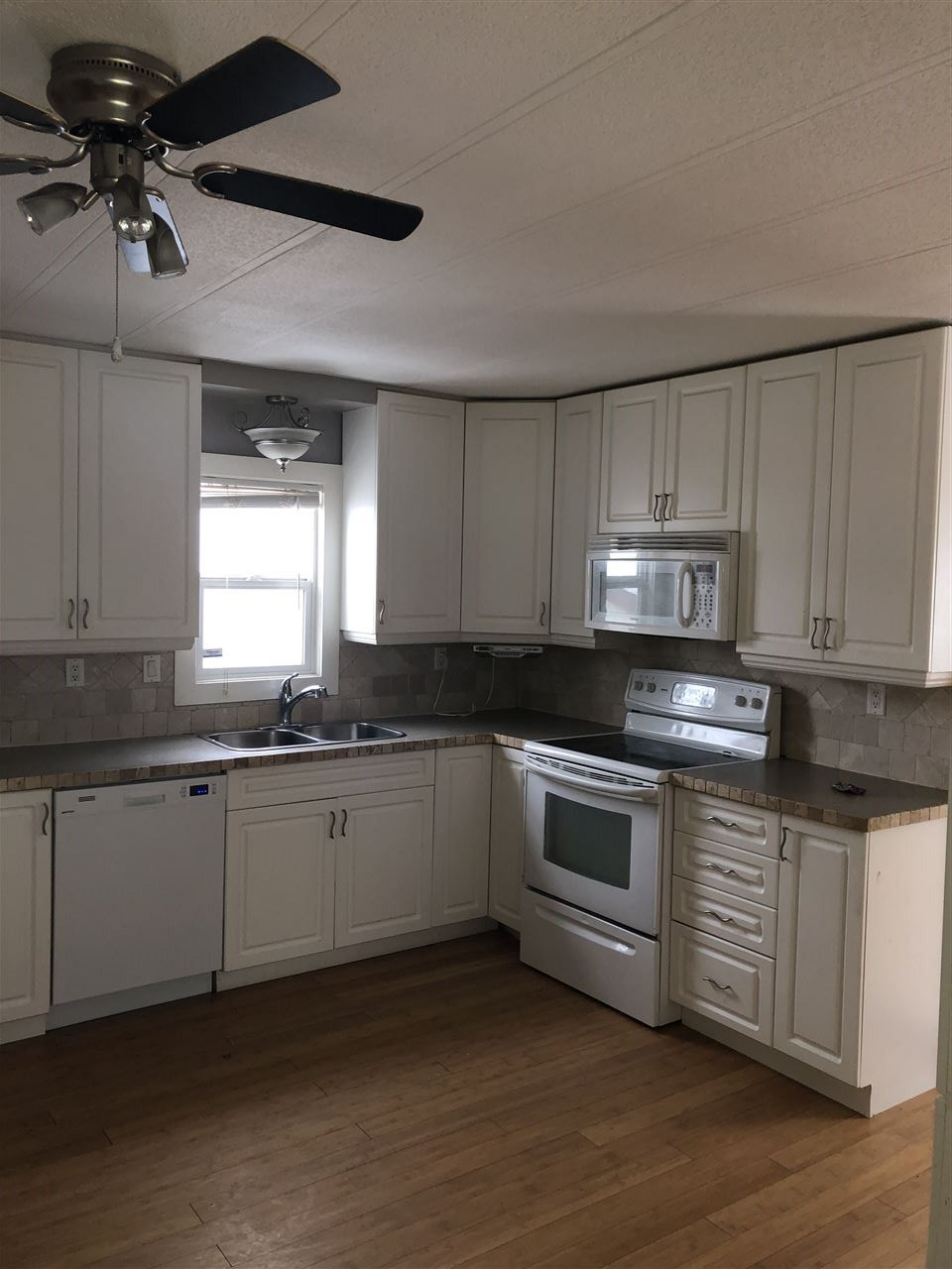 Backing onto green space! Foreclosure Alert...... This incredible 2 bedroom 1 bathroom mobile home has been recently renovated. It features a huge back yard with a storage shed. This unit will not last long.