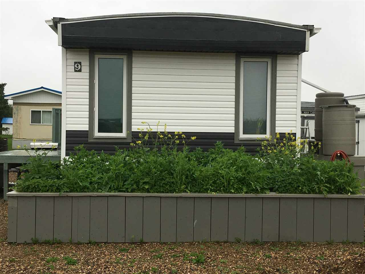 Better than new, this 2 Bedroom, 1 bathroom mobile has been completely renovated from top to bottom. New windows, siding, plumbing, electrical, flooring, paint and full bathroom renovations just to name a few of the upgrades. Conveniently located across from the Ryley School, this mobile home has one of the more spacious lots in the park. With reasonable lot rent and commutable distance to Edmonton, this home is affordable and move-in ready.