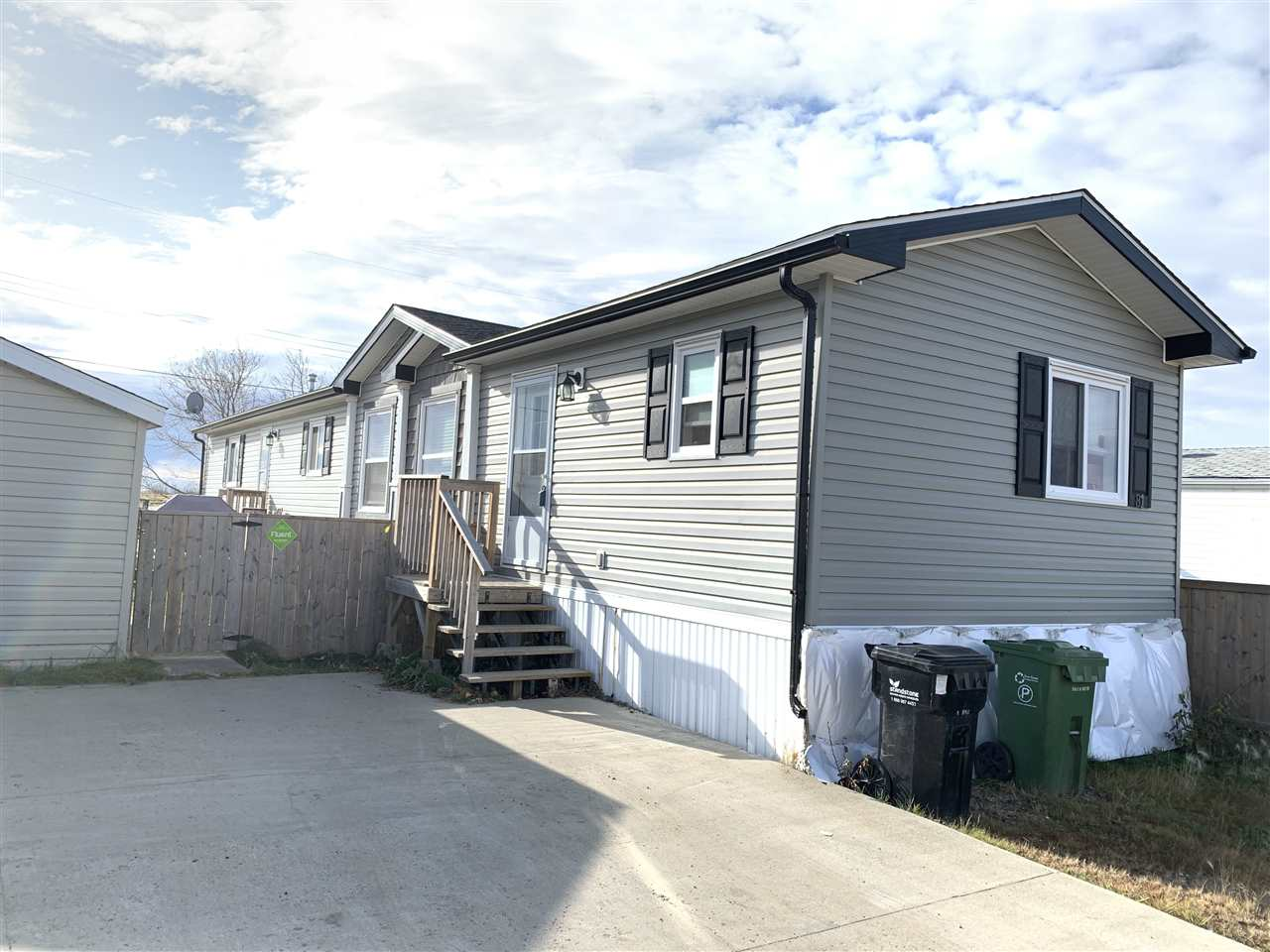 Newer mobile backing onto field in Westlock Trailer Park.  This 1216sqft mobile has lots of room and an attrative open concept. 3 Bedrooms with 2 located at one end with a 4 piece full bathroom and the MB is located at the other in with a 4 piece Ensuite and walk in closet.  Kitchen is bright and open to living room.  Yard is fully fenced with nice 5ft wood.  12x16 vinyl sided storage shed comes with property.  Close to schools and hospital.