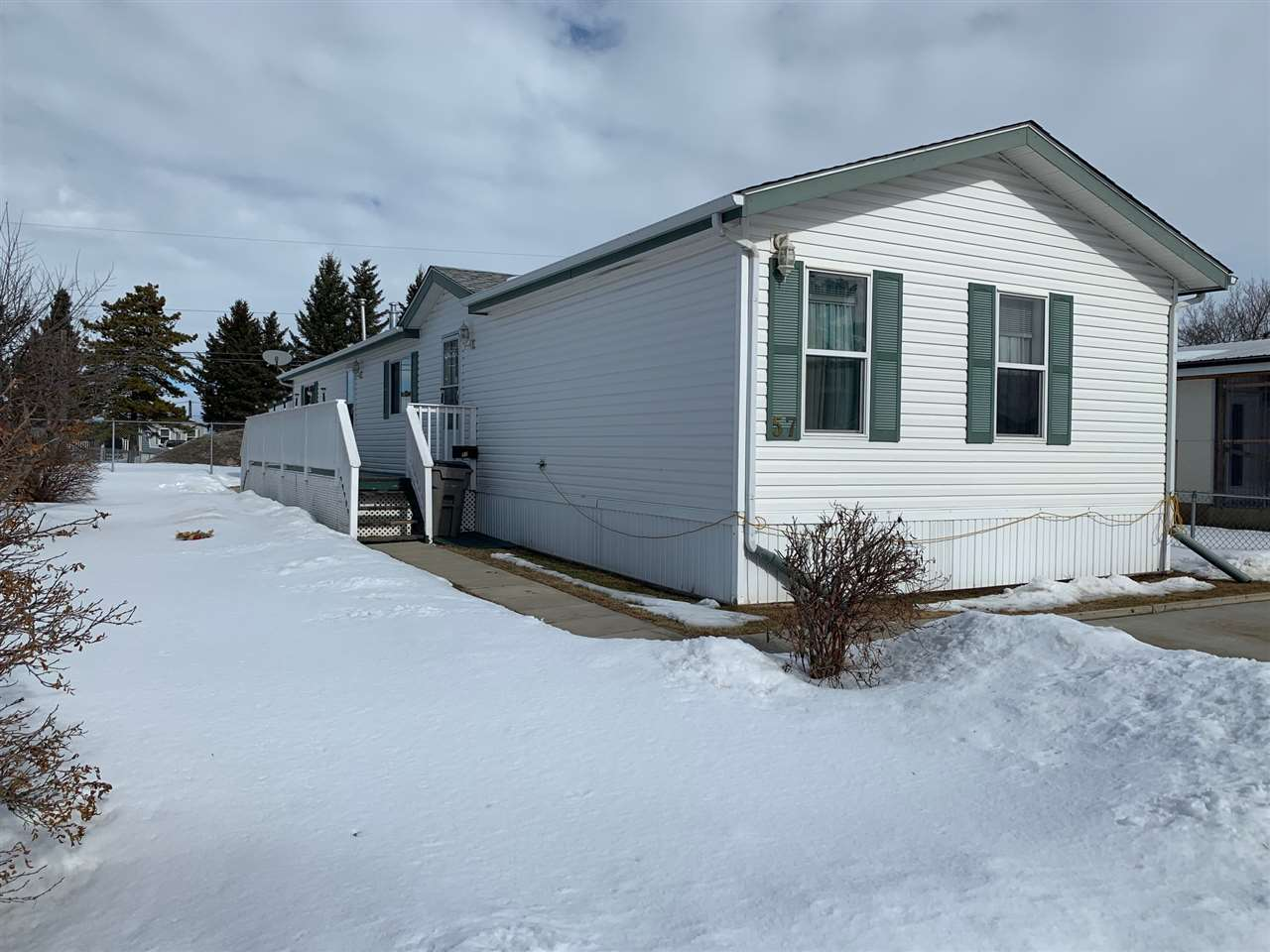 Very well kept 3 bedroom 2 full bathroom home with west facing deck and very nice yard. 1520 sq ft. living room plus family room, master bed room has oval tub 4 pc ensuite and large walk in closet. Close to all amenities