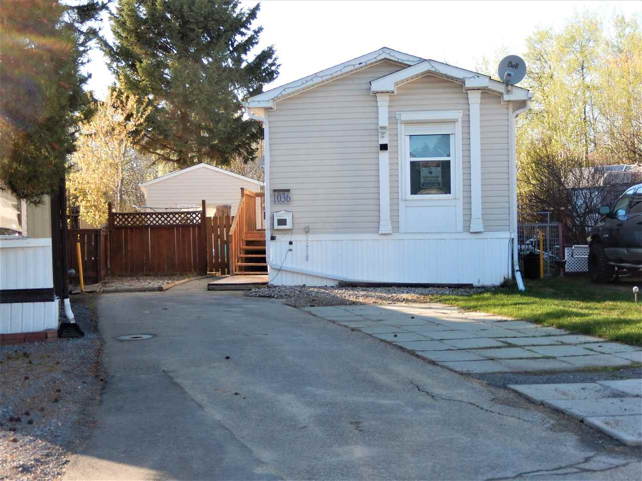 This 2008 with a LARGE DETACHED INSULATED/POWERED WORKSHOP sits on a private pie shaped lot BACKING ONTO TREES. The lot is FENCED and has a SHED & PORTABLE SUNROOM. The SHED has NEWER SHINGLES, is INSULATED & has POWER.  Sooo much to offer!  The home itself has 3 BEDRS (master/ensuite at the back), with 2 FULL BATHROOMS and a big LAUNDRY RM complete with WASHER/DRYER/FREEZER.  The home has NEWER APPLIANCES, CENTRAL AIR & OUTSIDE SHUTTERS on the windows for extra insulation and to keep the home cool in the summer.  Lots of PARKING as well! This park has much to offer and included in that lot rent is FREE use of the FITNESS CENTRE (with 4 big screen tvs). FREE use of the EQUIPPED COMMUNITY CENTRE. FREE use of the REGULATION SIZE OUTDOOR RINK...there are also PLAYGROUNDS, POND, WALKING TRAILS, STORE, GAS BAR, PUB, RESTAURANT and much more!  Westview Village is also very meticulous with their grounds & snow removal is done very efficiently.  Its a great place to live!