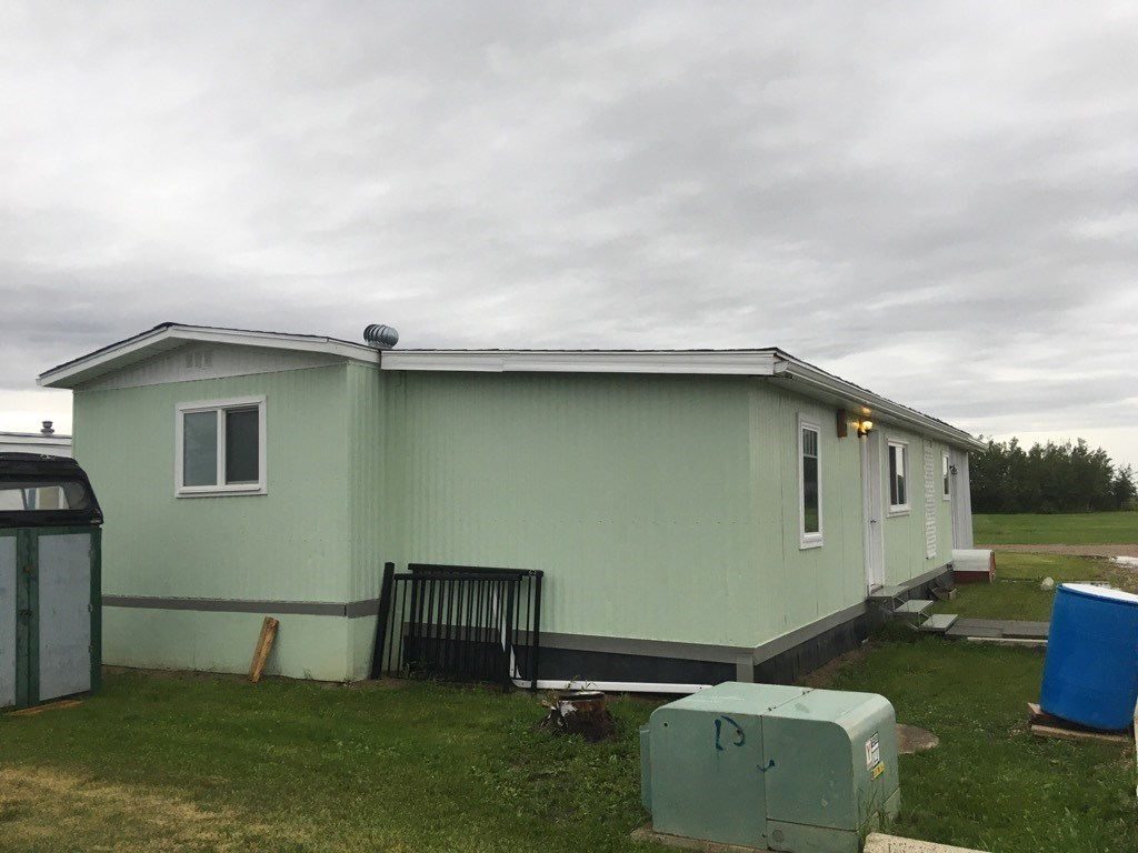 Spacious, fully upgraded, 2 Bedroom, 1 bathroom mobile home close to school in Ryley. Upgrades include new windows, new rubber tile roof, flooring, paint and full bathroom reno. The large 52'x12' addition adds plenty of space with 3 season porch and separate workshop area.  With reasonable lot rent and commutable distance to Edmonton, this home is affordable and move-in ready.
