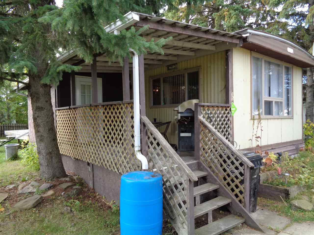 CHEAPER THAN RENT!! 14 x 64 1974 mobile home with 10 x 16 addition located in Westlocks Trailer Park. New windows in 2011, stainless steel appliances, 8 x 10 storage shed and deck. Located on corner lot with mature trees and yard space. Great opportunity for first time buyer!!