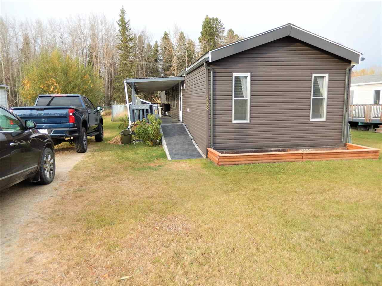 BACKS ONTO THE BIKING/WALKING TRAILS! You don't even feel like you are living in a Mobile Home Park! This home sits on a regular residential street, second home from the edge of the school field. Great Location! This 3 bedr, 2 bath home has only had one owner & has had lots of RENOS over the years! The SHINGLES, SIDING (2016), EAVESTROUGH (2018), FURNACE (2017) and they also replaced the TOILETS plus the LAMINATE FLOORING in Living Rm, Mastr Bedr.  There is LINO in the rest of the home. The home has GOOD SIZED BEDRS & nice LAYOUT. Ensuite has a JACUZZI.  The COVERED DECK faces West and the yard is FENCED other than the front and there is a SHED.  Mobile City sits in the heart of Spruce Grove and is walking distance to many amenities.