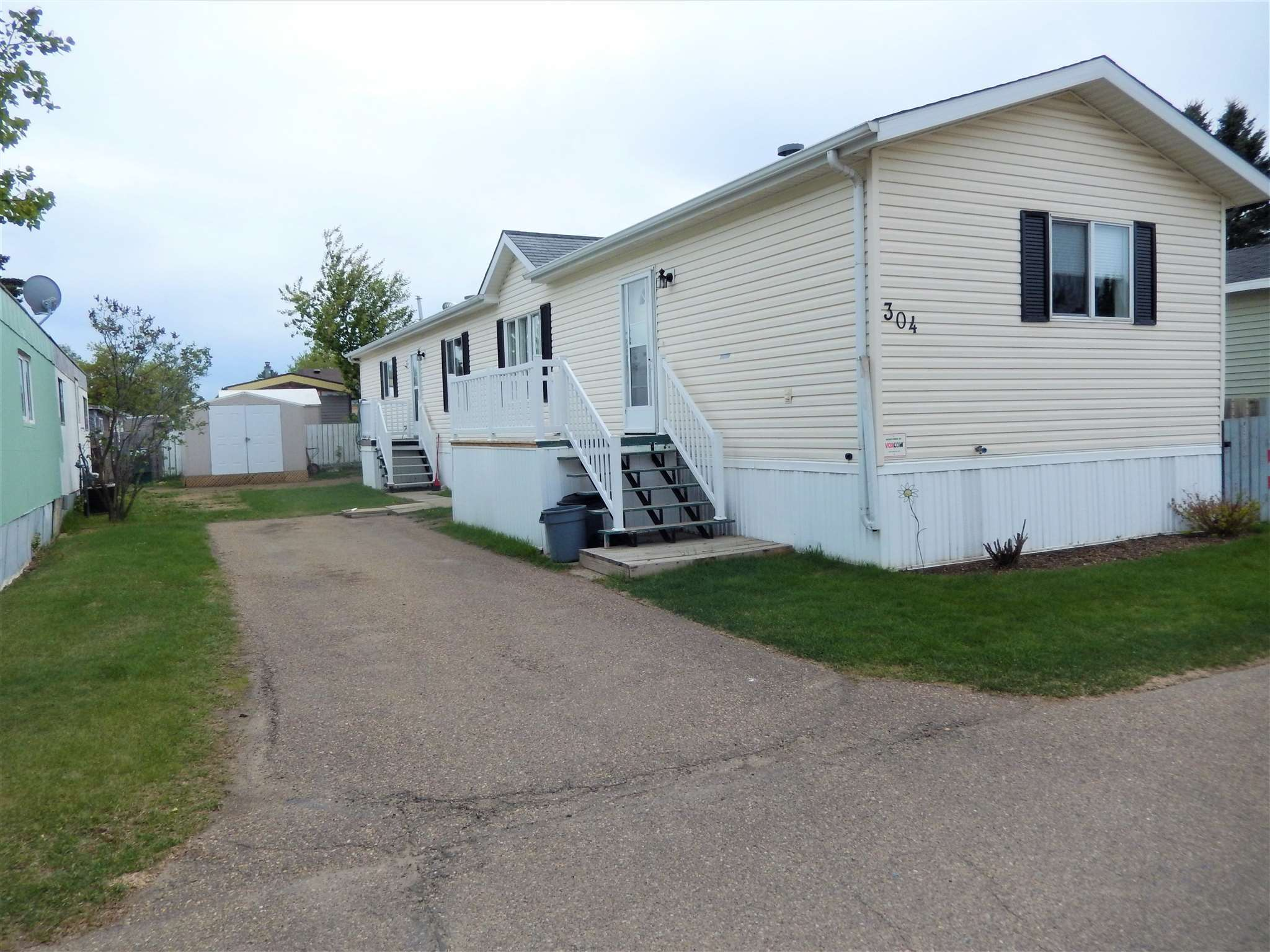 This well cared for NOBLE home has been in the same Family since it was new! Noble Homes are known for the quality of workmanship. This 3 bedr, 2 bath has plenty of BUILT INS in the Kitchen, Dining Area & the Living Rm, plus there is a BIG PANTRY. The Master Bedr sits at the back of the home & the ENSUITE has a CORNER JACUZZI. The SHINGLES are about 10 yrs old; the home was just RE-LEVELED and sits on cement & wood blocks; Both BATHR SINKS & TAPS have been replaced. There are NEWER BLINDS & 5 CEILING FANS! DISHWASHER is newer.  There is NO CARPET...just LAMINATE & LINO. This property is AVAILABLE for a QUICK POSSESSION!  Westview sits minutes to the west of Edmonton and is a very well maintained park and offers many services & amenities including a FREE FITNESS CENTRE, COMMUNITY HALL, SPORTING AREAS, POND, WALKING PATHS, PLAYGROUNDS,  STORE, GASBAR, PUB, & much more.