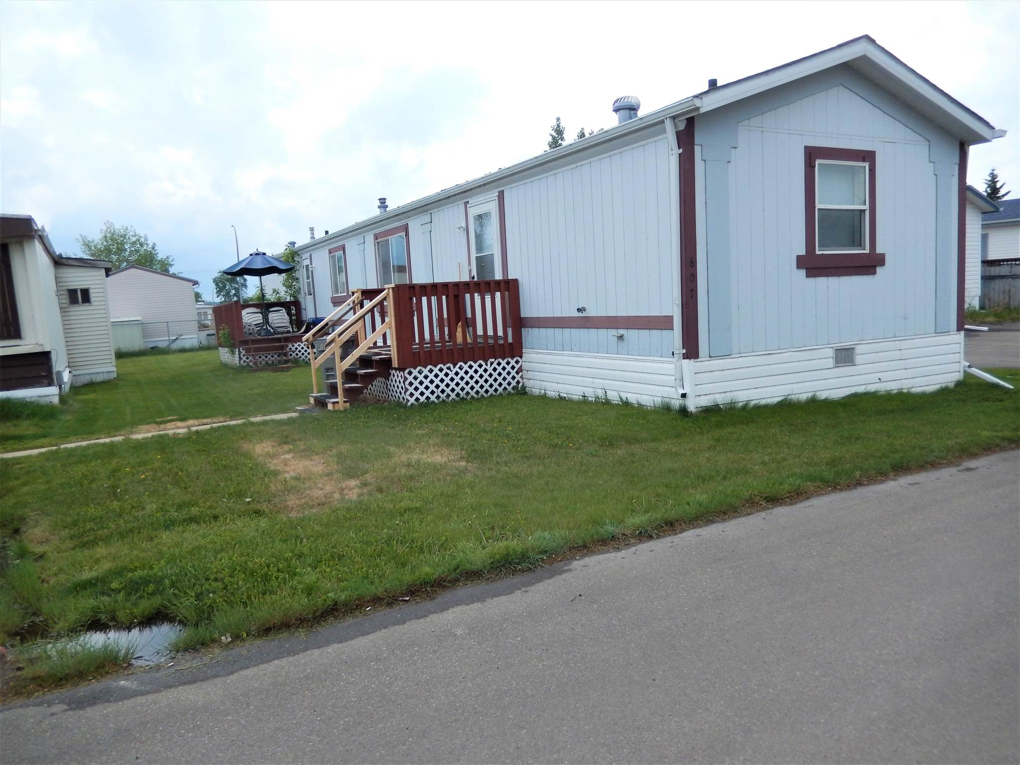 This 3 BEDR, 2 BATH home is super affordable. The KITCHEN has a CORNER PANTRY and a spacious DINING RM.  The Master Bedr sits at the back of the home  and has a WALK IN CLOSET. In the ENSUITE, sits a CORNER JACUZZI TUB.   On the front end of the home, is the MAIN BATHR & 2 more BEDRS.  There is a SEPARATE LAUNDRY ROOM which leads out the back door.  The FURNACE has been well maintained over the years and both TOILETS were replaced as well as some PLUMBING underneath & the HEAT TAPE (2020).