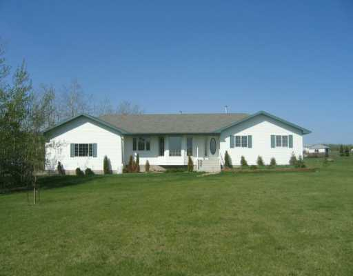 Very nice bungalow on 3.2 partially treed acres. Almost 1600sq. ft. features  big country oak kitchen with island,garden doors to large west-facing deck;spacious living room with bay window and cozy gas fireplace;good sized master with swirl tub;huge 29x23 finished heated garage;view of the lake;on city water line;appox. 15 minutes to Sherwood Park.