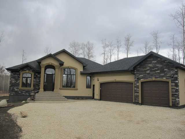 "Absolutely gorgeous custom-built bungalow on 2 pretty,treed, private 2 acres backing onto 14000 acre Ministik Bird Sanctury. Only 20 minutes to Sherwood Park, south Edmonton, Beaumont, Leduc, Nisku. High quality craftmanship with attention paid to detail. Beautiful maple kitchen, granite c-tops and high end s.s appliances. High ceiling great room with floor to ceiling stone fireplace. Large master with elegant ensuite, jet-tub, double shower and sinks. Formal dining and generous breakfast nook with access to a large deck. Main floor laundry. Fully finished basement has 4th and 5th bedrooms, huge rec room, 5 pce. bath and very nice media room c/w wet bar and 130"" projector screen. Triple heated garage. Tasteful use of stone pillars, crown moulding, granite, hardwood, travertine tile, high grade carpet. Impressive in every detail."
