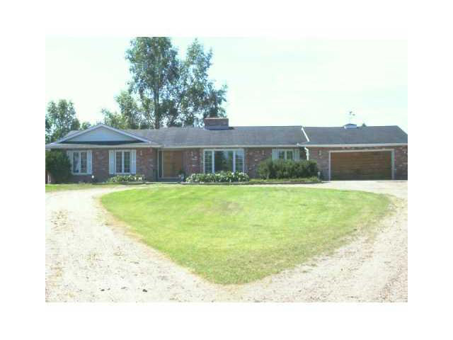 REDUCED 10M !!Huge reclaimed brick bungalow on 3 pretty acres about 12 minutes to Sherwood Park. Over 2100 sq. ft. of well designed living space plus a large rec room in the basement. Large country kitchen with lots of cabinets. Family room has attractive coral stone gas fireplace/feature wall, cedar ceiling. Big living room has french doors, a second brick wood- burning fireplace. Formal dining area. Good size bedrooms. New high efficiency furnace and HWT. Good value here.