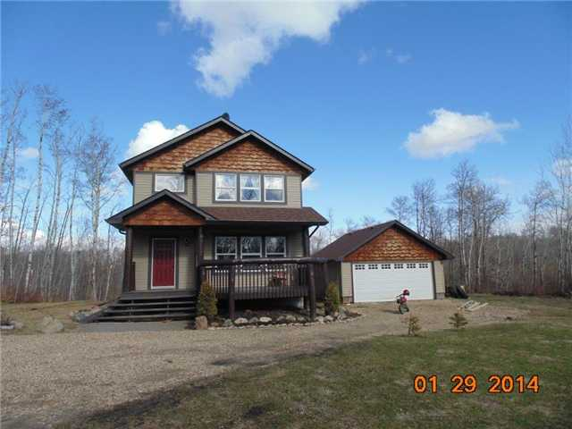 This lovely country home features 5 Bedrooms and 3 1/2 Baths. Plenty of room for your large family here! The eat in country kitchen has loads of cabinets and counter space including a convenient built in desk. The flex room beside the kitchen can be used for your dining pleasure or could easily be your office, den or music room. The large bright living room has plenty of space for the family and guests. Main floor laundry and a half bath complete the main level. Upstairs you'll find 4 good sized bedrooms and 2 full baths. The basement is fully finished with a large 5th bedroom, a 2nd family room plus another 4 pce bath. You'll love the peace and tranquility here with 38 acres of nature all around you including a natural pond. Plenty of space to build a large SHOP too! BEAUTIFUL PROPERTY!