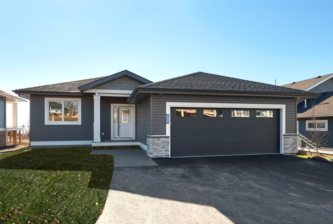 "The ""Poplar"". Easy commute to the city! Very pleased to present this gorgeous Brand New 1432 Sq Ft Bungalow. HUGE Open concept kitchen with loads of wood cabinetry capped in granite and a large island that makes way to the dinette and living room. The living room with gas f/p flows out to a large lake-facing covered deck. The main floor blanketed with hardwood floors and is host to the Master suite, powder room, laundry room and 2nd bedroom. If you want more space, the basement can accommodate a family room, 2 more bedrooms and an additional 4 piece bathroom. Located in a gated (not age restricted) community. Did I mention the Oversized double attached garage. This community offers amenities such as a private marina, clubhouse, fitness centre, hiking, beach volleyball, and a gorgeous waterfront outdoor pool."