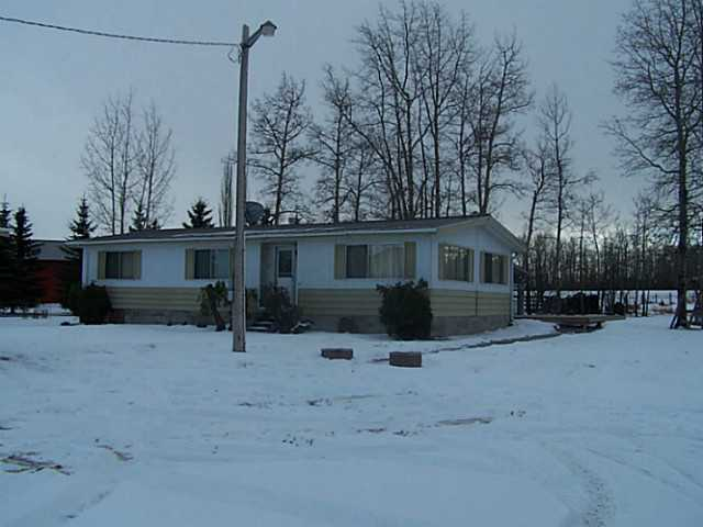Situated on the edge of Warburg on 1.0 acres. Private acreage offers mature trees and landscaping, shale driveway, 24 x 34 heated double detached garage with 220 wiring, storage shed and a 1400 square foot modular home with addition. Ideal for the growing family. Kitchen, living room, dining room, master bedroom with 4 piece en-suite, 2 additional bedrooms , family room addition and 4 piece bathroom complete the home. Exterior is maintenance free with metal siding and metal roof. The wrap around deck is partly covered. The seller is motivated to sell! GST may be applicable.