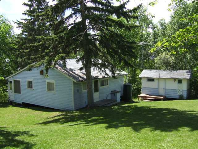 Quick possession and just in time for summer! Cozy 800 sq. ft. cottage located at Lakeview on Lake Wabamun, only 45 minutes west of Edmonton. Beautiful, private .44 acre lot surrounded by mature trees with landscaped yard and garden area. Living roomwith wood-burning fireplace, kitchen with nook area as well as dining area in front of a large window with lake view. Three bedrooms, fridge and stove included, as well as all furniture, window coverings and 2 sheds. Lots of room for RV parking. Close to the lake with private beach access, dock, owners boat house, playground and picnic area.