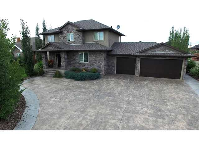 Sitting on 0.54 acres, this stunning custom built 2,838 sq. ft. 2 storey home is located in the community of the Banks of Sturgeon County. The open main floor features a formal dining room, breakfast nook with French doors to the backyard patio, beautiful kitchen with granite countertops, Stainless Steel appliances, 2-tiered island and pantry that opens to the warm and inviting living room with stone surround gas fireplace. Ascending the open riser staircase with custom glass railing you'll find a great room with 13 ft. ceiling, floor to ceiling windows, and 3 bedrooms including the master with 5 piece ensuite and large walk-in closet. The lower level features a games area with wetbar, in-floor heating, full bathroom and 2 additional bedrooms. A spacious, fully landscaped yard with a stamped concrete patio, rock water feature, firepit, detached heated shop, and attached triple-car heated garage are part of this beautiful home.