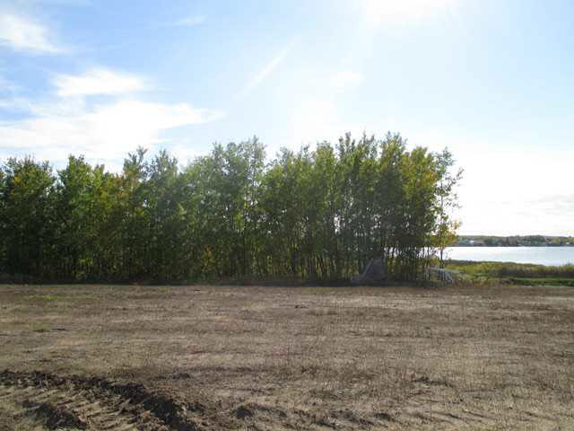 Lakefront lots on Moose Lake! The prestigious new subdivision of Lakeside Village offers various lots that back onto the environmental reserve to the lake, perfect to build that dream home. This 0.51 acre parcel has nice South facing views of the lake and not far from the lake access. With paved roads, municipal water and sewer, and only minutes from town, opportune lake living starts here!