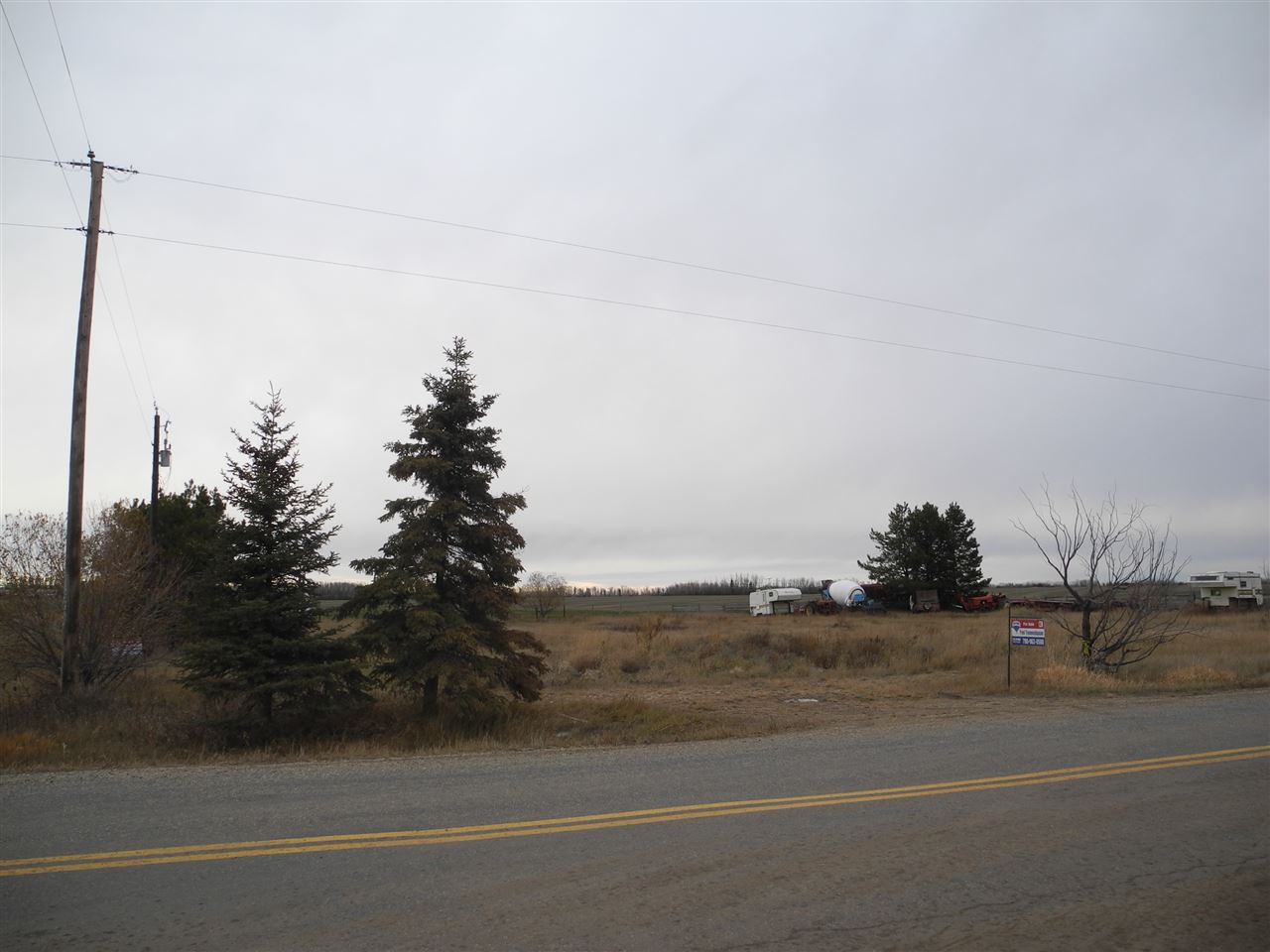 On pavement and out of subdivision you will find this 1 acre property ready to receive your new home. Easy commute to town and nice flat site.