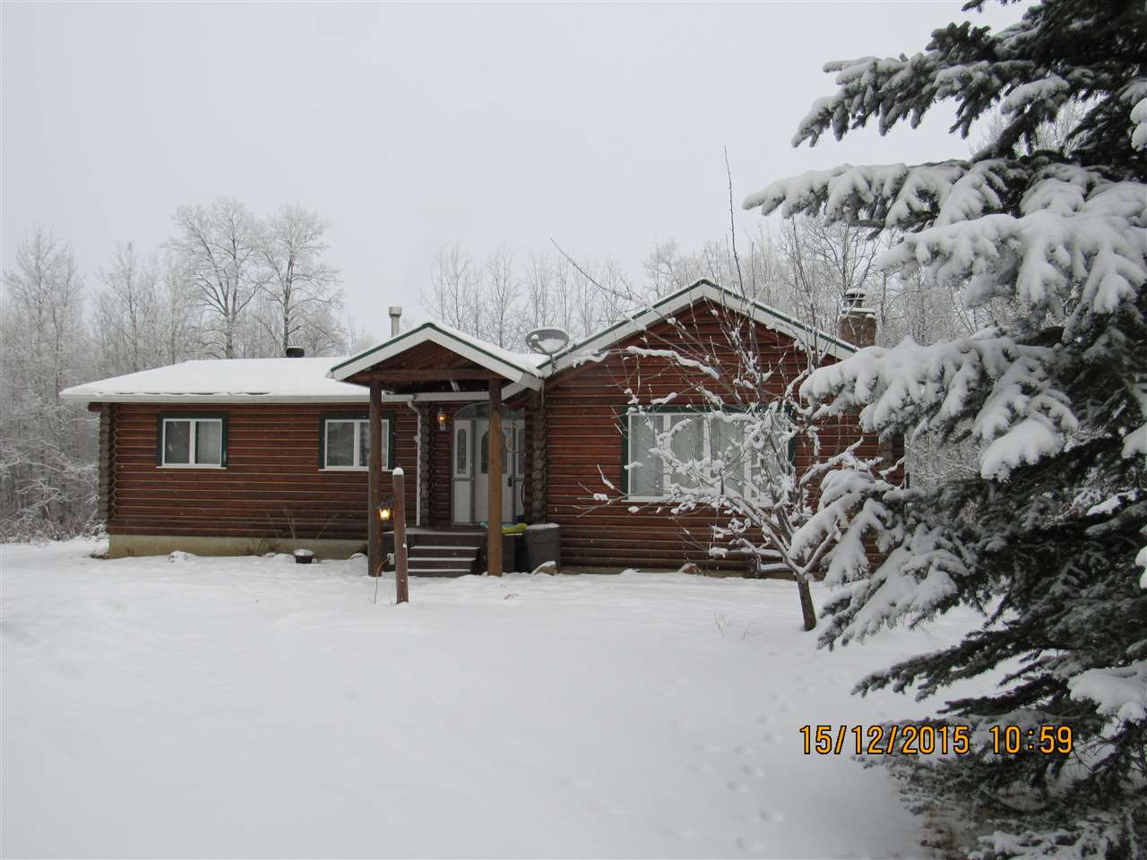 Come visit this Log Home among its treed and private setting only 15 minutes west of Stony Plain.The spacious entrance welcomes you and will invite you into the family room with vaulted ceilings and a beautiful stone fireplace with a free standing wood stove for those chilly winter evenings.  This home has had many upgrades over the last few years.  The hardwood was re-done, an amazing new kitchen with a granite eating bar, and two new bathrooms.  Your Dining room overlooks the private treed back yard.  The kitchen has all newer appliances also.  A total of four bedrooms with three upstairs.  The master has patio doors to the rear deck and his and her closets as well as a 3 pc ensuite.The walkout basement is mostly unfinished waiting for your creativity. This property feels like  a park.  Welcome Home!!
