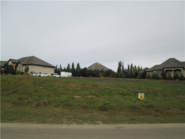 Very unique lot which is almost 1 of an acre in size. This sloping elevated lot gives a person the option to build many different types of homes. A walk out basement is definitely a possibility. If you would like one of the last large remaining lots in Riverstone Pointe then this could be the one for you. Show and sell with confidence.