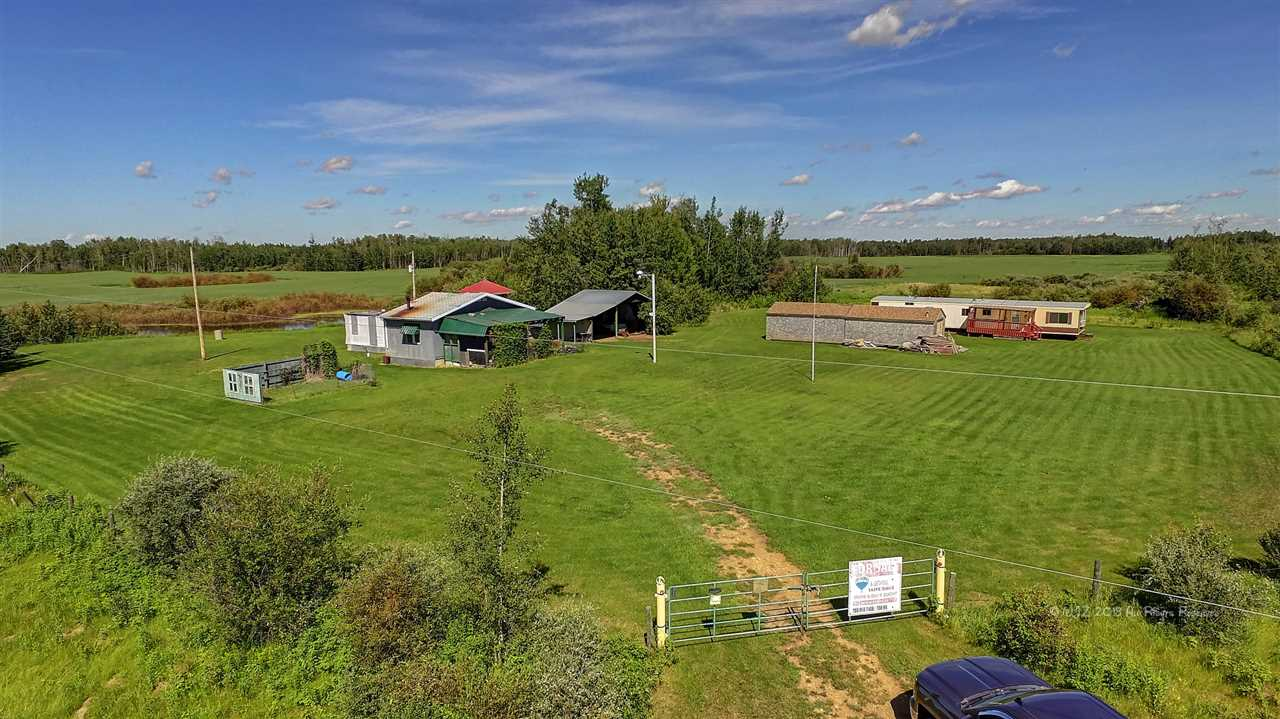 This 10.01 acre parcel of land is a great weekend retreat. The property has an  older home and several older out buildings.  There is also a  modular home on the property, built in 1978.  The modular is not hooked up to any services.