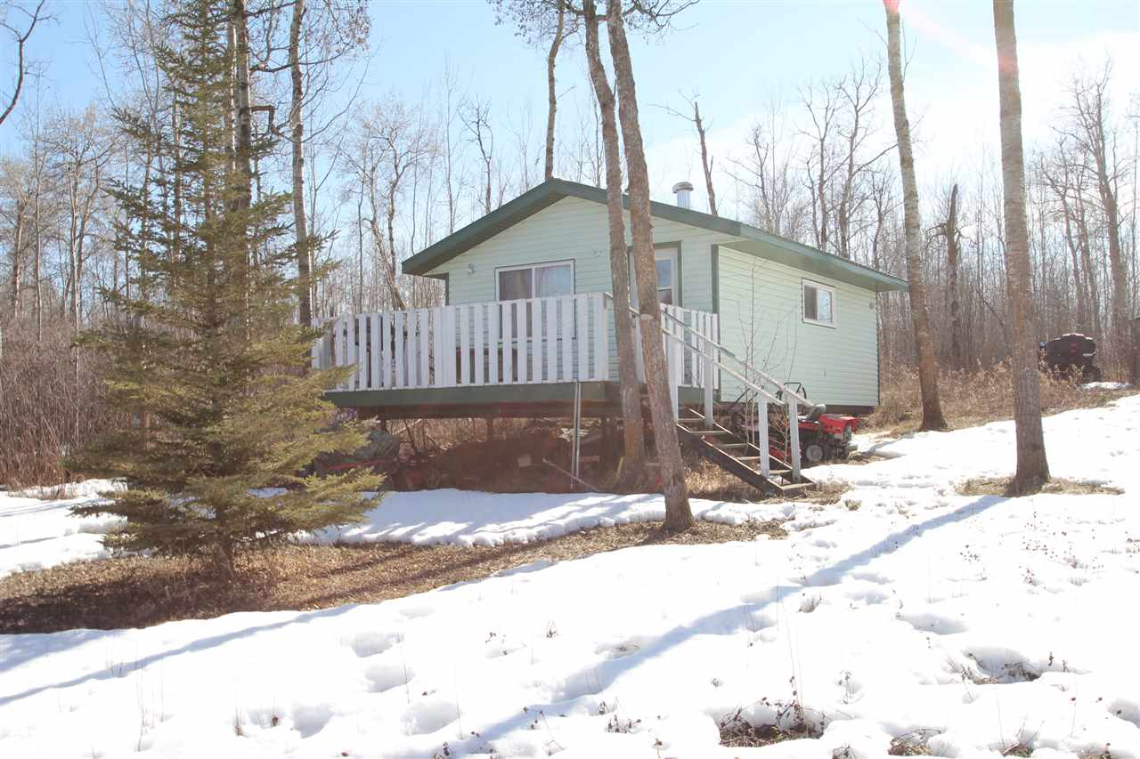 ?Lake Front at Vincent Lake? Come & get away from it all, this 0.56 acre lot is in a quiet cul-de-sac. Enjoy sitting by the camp fire on those nice summer nights or staying warm by the wood stove in your 16 X 24 cabin. Lots of room for visitors to bring their campers, or to store your extra toys. This lot can be enjoyed summer or winter!