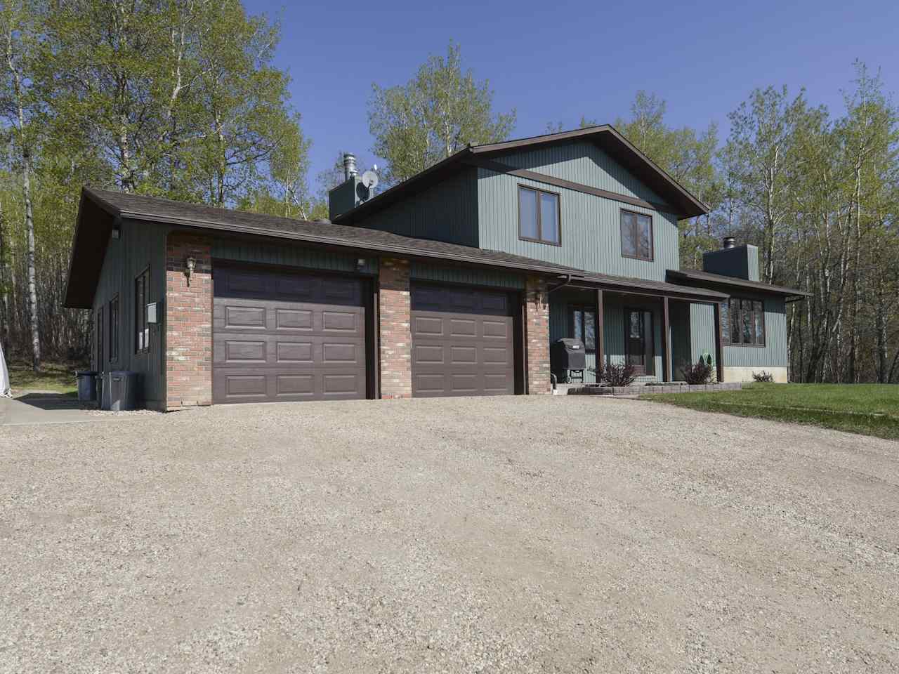Exceptionally well maintained 5 level split on 2.99 acres minutes north of Spruce Grove on Jennifer Heil Way and Campsite Road.  The view from the property back to Spruce Grove and Edmonton is stunning! 1920 sq ft is at grade. 4 levels are fully developed with the 5th available for development. The main floor features living room, dining room and kitchen. The upper level has 3 bedrooms, full bath and ensuite. The 3rd level has a large family room, office, laundry and entry to oversized 25ftx28ft garage. The 4th level has a recreation room, hobby room and 4th bedroom. Loads of upgrades include: S/S appliances, water heater (2002), furnace (2010), 35 yr shingles (2012), septic field (2013) and iron filter (2006). A Great Family Home minutes to Spruce Grove services!