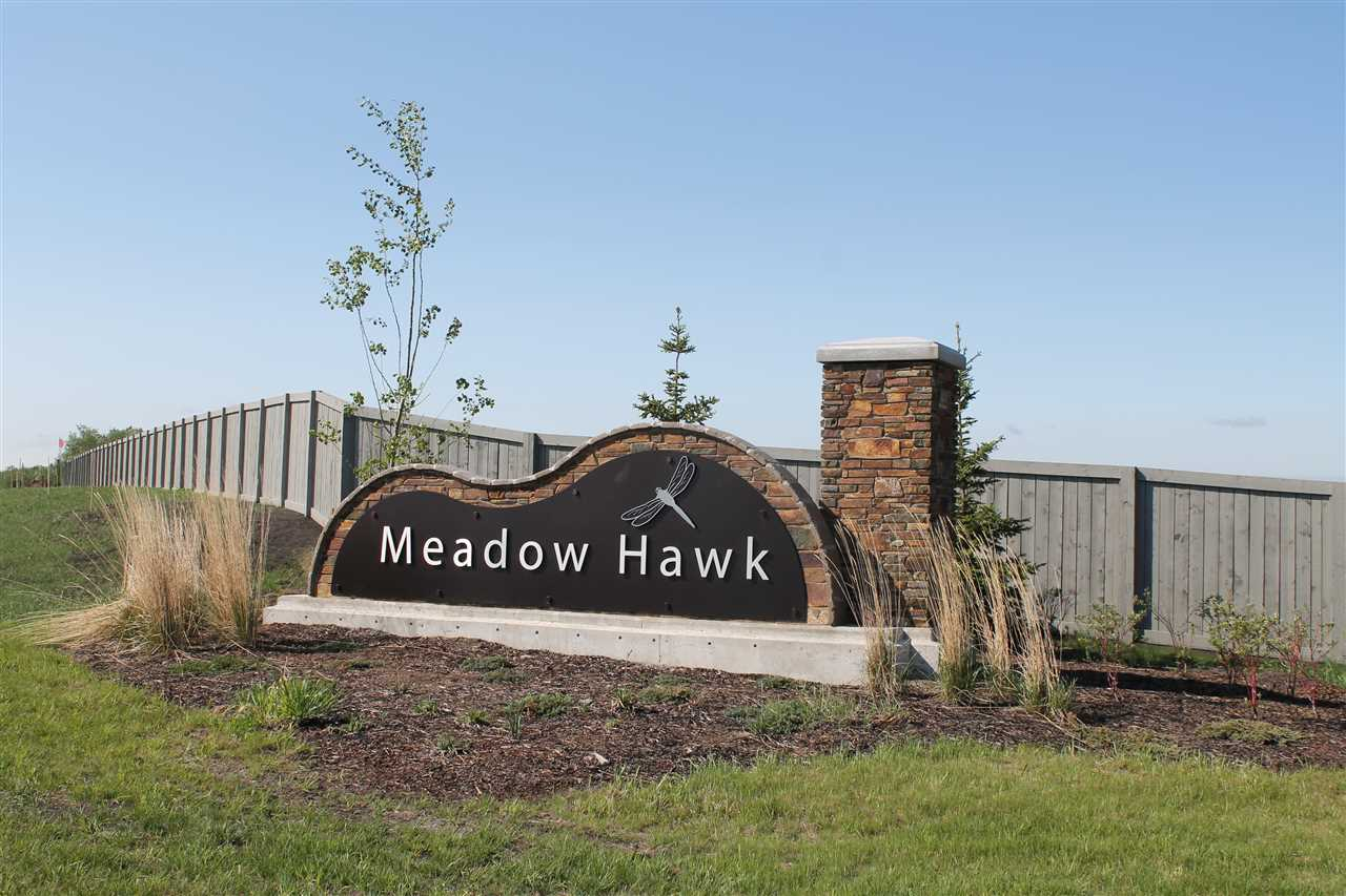 MEADOW HAWK Sherwood Parks Premier Subdivision located just 1/4 South Of Wye Road and Cloverbar Road . This Country Estate Subdivision Features Lots Ranging from 1/3 acre lots to 1.73 acre lots . Standard and walkout lots left . Municipal Services, Paved trail to Sherwood Park , 40 Acres of park and Ponds Over 65% sold and Numerous homes under construction . Don't Miss out on this Amazing Opportunity    This Lot is a .38 Acre  WALKOUT lot Backing Onto Lake