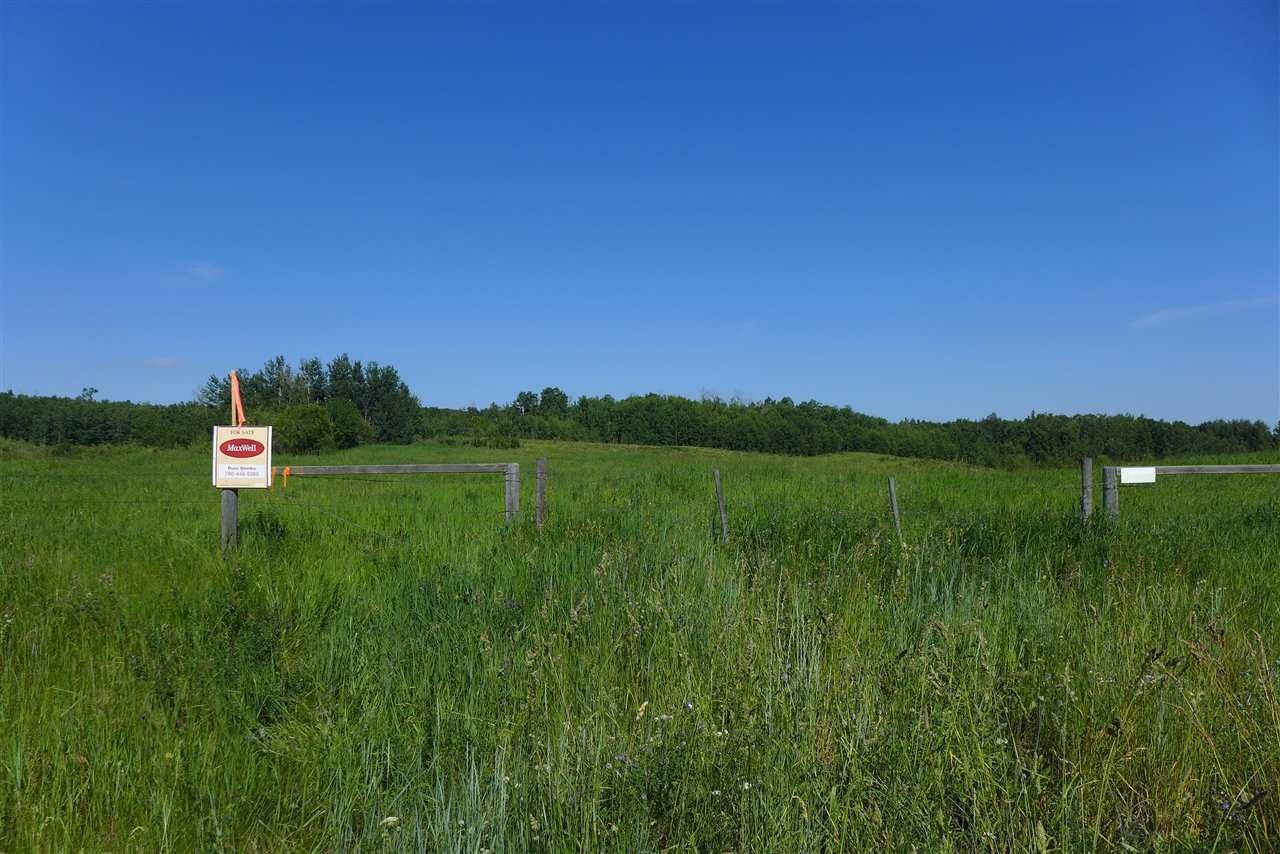 A BEAUTIFUL 9.32 ACRES ON PAVEMENT 30 MINUTES EAST OF EDMONTON IN GROUSE MEADOWS. BUILD YOUR DREAM HOME HERE OR HAVE THAT WEEKEND GET-A-WAY OR JUST OWN A PIECE OF ALBERTA. This great lot is rolling with trees and several great building sites. Power and gas are at the property line. This is a must see.