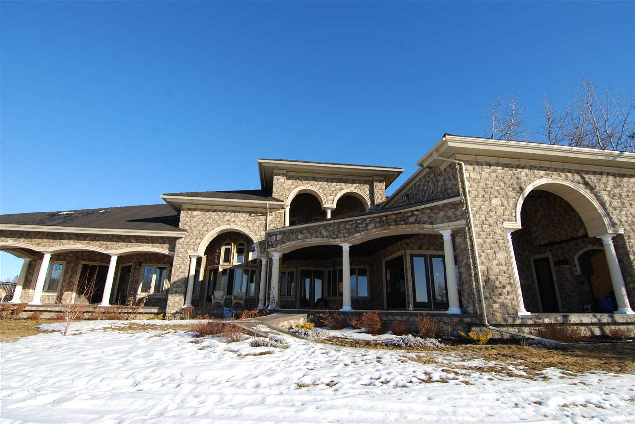 Spectacular2.65 acre property backing onto the North Saskatchewan River with incredible views. Custom build with over 13,000 sq ft, indoor living space including a 5 vehicle garage.  City amenities in a country secured setting, 10 minutes to Edmonton and a easy commute to international airport.