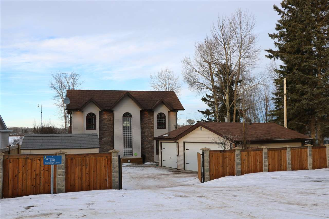 YOUR RETREAT AWAITS!! On the amazing shoreline Nakamun Lake you will find this almost 2500 sqft 5 bedroom Custom Home. Large lake facing new windows present the living room with spectacular views. Plenty of room and cupboards in the large country kitchen with eat up bar, tile flooring, and resin sink. The Kitchen, Family room and Main floor Den each have garden doors out to the half wrap around deck with custom glass rail. The Living room has a wood burning f/p and main floor family room has a gas f/p...best of both worlds. Two large bedrooms plus a 3 piece bath & laundry round out the main. Upstairs you'll find 3 more bedrooms, one with Juiliet Balcony and a 4 piece bath. Down the clearstory staircase on the lowest level is a bonus room/man cave. The property is fenced with a gate and has a heated triple garage. Enjoy swimming, watersports, and fishing right outside your front door!!