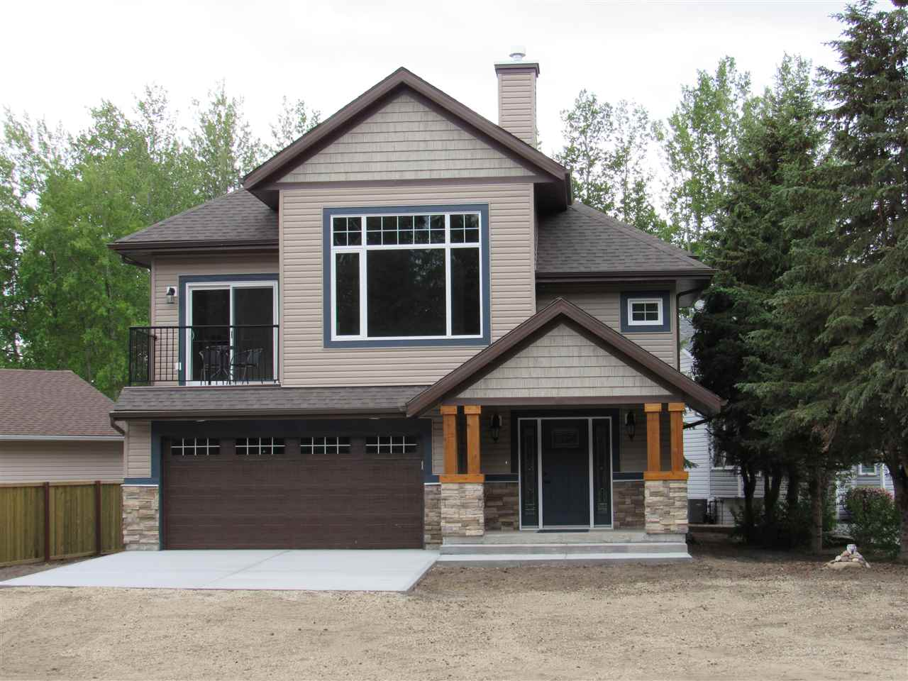Must see NEW home in the beautiful lake community of Ross Haven. Only 45 min drive from Edmonton, only 2 min walk to Lac Ste. Anne for all your boating, kayaking and water activities. Spray foam insulation keeps heating cost at a minimum! Main floor has travertine tile through out. A large bedroom with WIC can is great for guests or an office with ample storage. Family room has a gas fireplace and opens up to a large deck and great backyard. There is also a concrete pad ready for a hot tub or to be closed in for a sunroom. The second floor has elegant engineered hardwood throughout. 9ft ceilings on the 2nd floor with HUGE 12ft in the living room. A gas fireplace with stacked stone surround also highlights this space. Open concept kitchen/dining room with patios off both sides give you ample space for entertaining. Chefs kitchen with high end stainless appliances and granite counters. 3 bedrooms including the master on this floor, jacuzzi tub and stand alone shower in ensuite! Perfect retreat to call home!