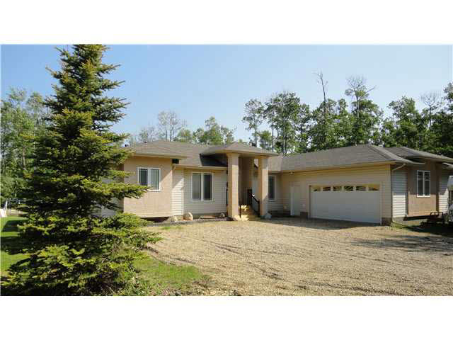 This 2,215 sq ft executive-class bungalow is located 15 minutes from Sherwood Park, on 2.7 acres. This home has many beautiful features such as open floorplan, ceramic tile, NEW hardwood 2015, main floor laundry/mudroom and NEW roof in 2016 with transferable warranty. This home has 4 bedrooms on the main floor, it is a stunning blend of old-world class and modern design and is a true estate home. It features a gourmet kitchen with newer glass tile backsplash, a large corner pantry, peninsula Island and patio doors that lead to the 2-tier deck. The living, dining and family rooms are large, warm, functional and inviting. The luxurious master has a fireplace, large walk-in closet and an ensuite with a 2-person Jacuzzi tub, a corner shower and his & her sinks. The home offers 2 more large bedrooms with access to a Jack & Jill bathroom. The basement is partly finished with a large rec room and plenty of room for future development. The oversized heated 22x26 double garage has LOADS of room for all your toys!