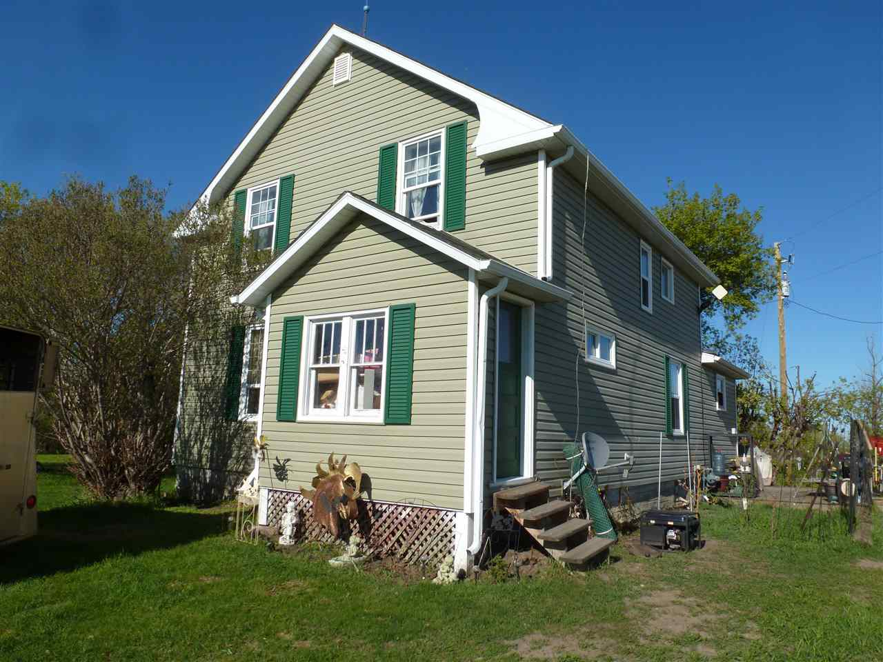 **REDUCED & READY** New Price - *$262,999!* 16.53 Acres with older house and barn - formerly a homestead. This Semi-Bungalow or One and a Half Storey style house is estimated to be of 1936 vintage, although Beaver County puts the effective age at 1950. Some improvements have already been done and more are in progress. The exterior of the house, i.e. siding, roof and windows have been upgraded, while much of the interior is original. The main floors features a small country kitchen, the Dining Room and Living Room with newer laminate flooring, a 4-piece bathroom and a Bedroom. The upper floor houses 3 Bedrooms along with a walk-in closet. The Basement has never been finished, and is used for utilities and storage. The Big Red Barn could use some TLC, but is functional with assorted stalls and pens. There is a dug-out on the SouthWest corner of the property. This property with its character house  has tremendous potential and sits in a great location, a mere 4 paved minutes North of the Town of Tofield.