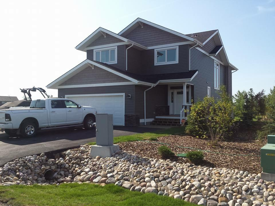 Very pleased to present this gorgeous 2350 sqft  two storey home with lake views in a gated community just west of Edmonton. This home features the High end touches such as wood cabinets, granite counters, stainless appliances, hand-scraped hardwood and central a/c. Amazing layout on the main with HUGE ISLAND kitchen with pantry room/ Wine Wall, stone gas f/p in living room, formal dinette with huge lake facing windows as well as a bright open stairway. There is a bonus room upstairs with vaulted ceilings, amazing views and access to a 2nd level deck. Also on the 2nd floor you'll find the master suite with fantastic views, a 5 piece ensiute, and an absolute dream dressing room with built-ins for all your fashions and accessories. There is a 2nd bedroom, a 4 piece bath and laundry upstairs as well. In the fully finished basement there are 2 more bedrooms, another 4 piece bath and a family room. Outside you'll find the large South facing deck with Hot-Tub. The oversize garage measures 27x23.