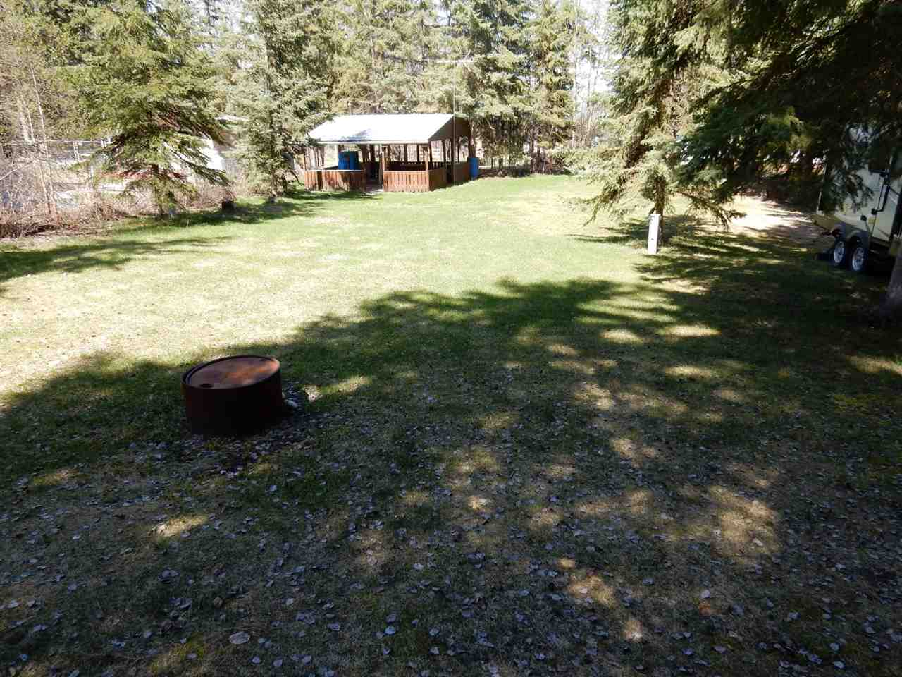 """""""PARTIAL LAKE VIEW"""" of Lac La Nonne Lake from this 150 x 73 x 117 x 65 foot lot. Build your """"DREAM HOME"""" or """"PARK YOUR RV & ENJOY"""" the 21 ft x 18 ft cook house that has power,refrigerator and satellite TV. There is an outhouse with a 100 gallon (aprox) holding tank, two storage sheds & fire pit as well as mature trees. There are power plug ins throughout this lot for recreational vehicles. This property is located on a dead end road so there is very little traffic. Lac la Nonne Lake is known for it's """"GREAT FISHING"""" for Walleye,Northern Pike,Whitefish and Perch. There is a public boat launch, as well as a grocery store. This lake reaches a depth of 60 ft toward the west end. Boating and water sports are common on the lake however it doesn't get overly busy. Deer, moose, Elk, Pelicans & lots of other wildlife. This is one of the """"NICEST LOTS AVAILIABLE THAT OFFERS A PARTIAL LAKE VIEW!!""""  Less than an hour to Edmonton & 15 minutes to Barrhead. GST if applicable, shall be the responsibility of the purchaser."""