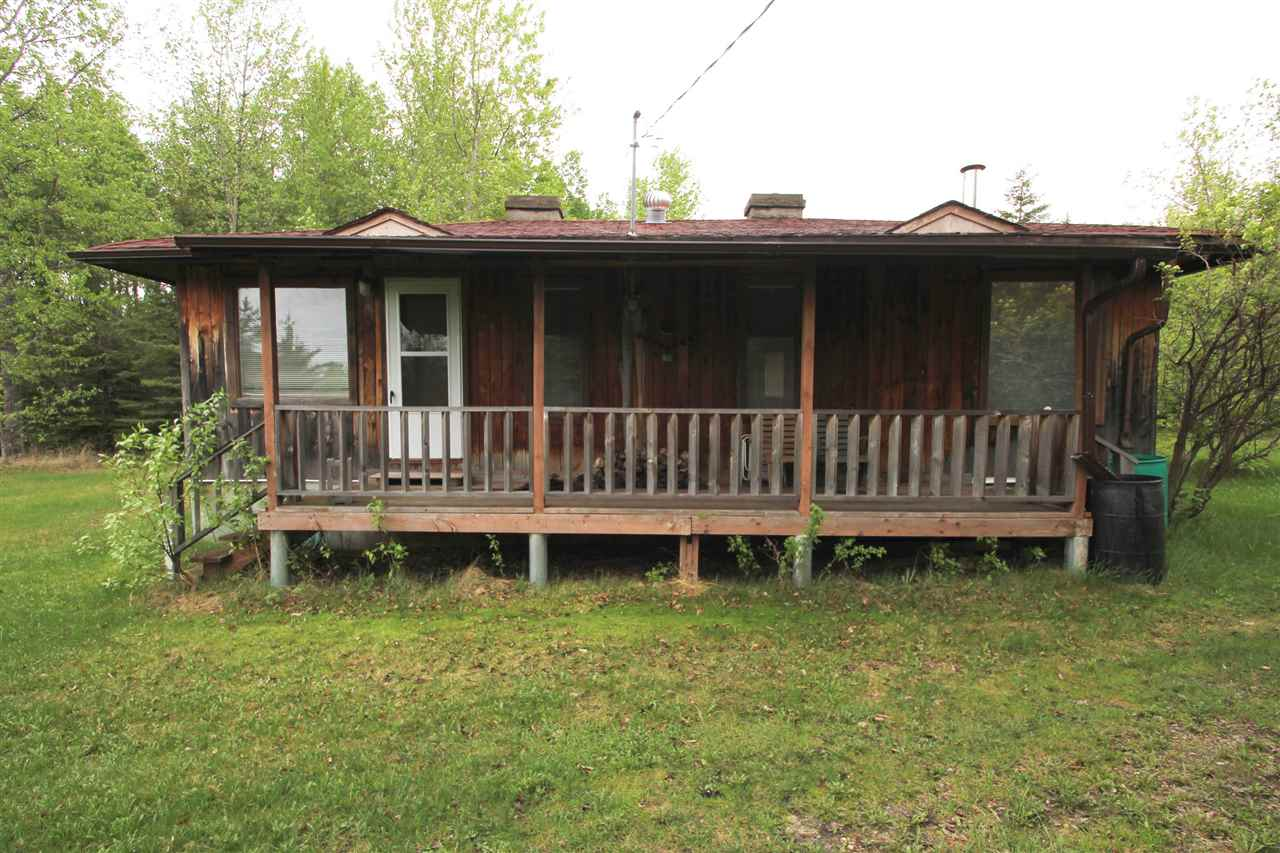 ?Upper Mann Lake? This year round living cabin that boasts a nice scenic area is located on a corner lot on Hilltop Drive. Property includes a water cistern and a septic holding tank, as well as two bedrooms, along with a nice, open living area.