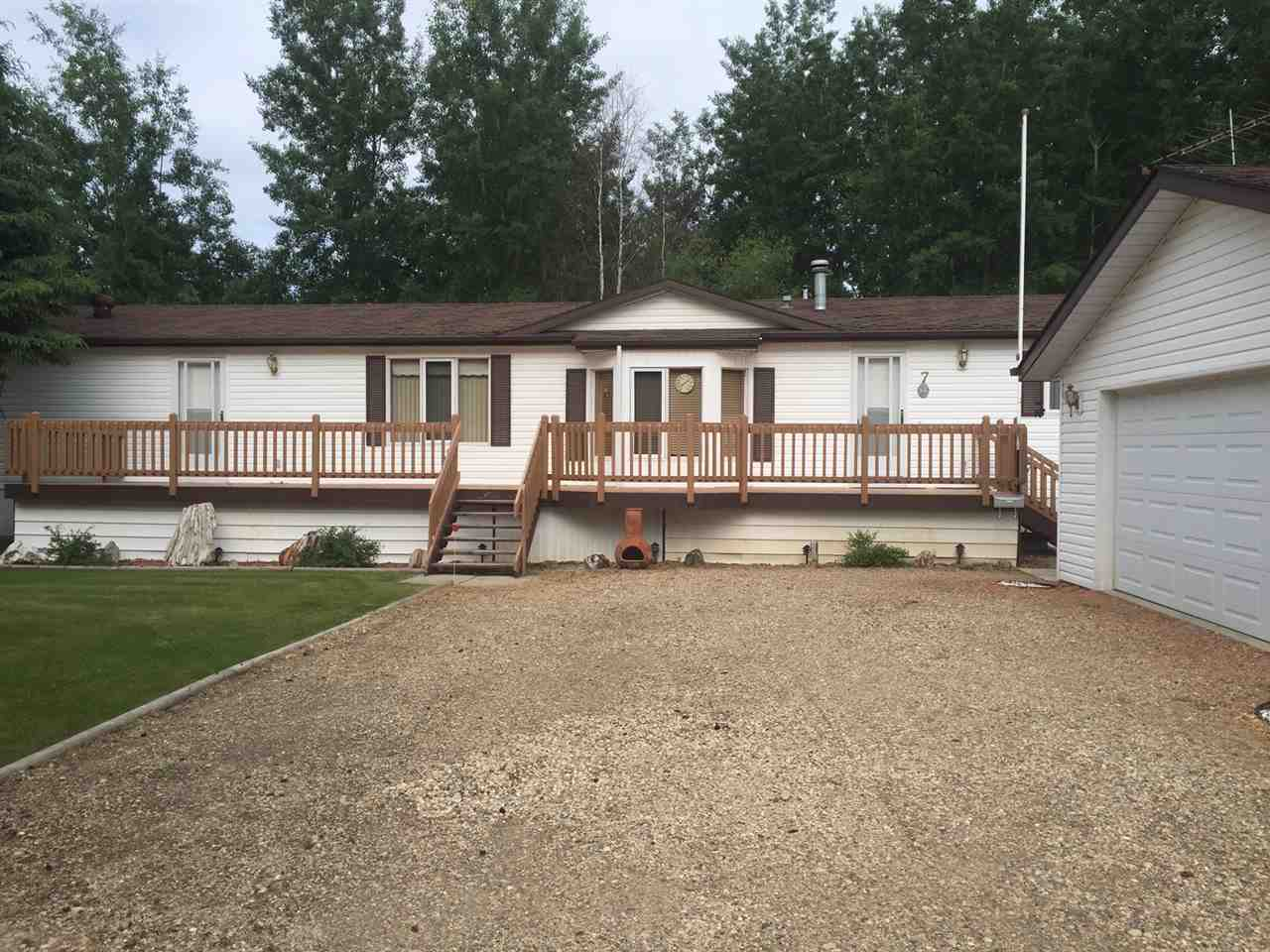 Well kept mobile in Birchwood Village Greens! This lovely mobile home sits on a 0.4 acre lot with lots of trees. The 16' wide mobile is in fabulous condition and features 3 bedrooms, an open concept floorplan and newer flooring throughout. The large kitchen has plenty of cupboards and counter space, and the skylights allow for plenty of natural light. Outside you will find a massive deck off the front and a 2nd deck off the back door, a 24x28 fully finished garage and a peaceful forested back yard. Birchwood Village Greens is located on the Birchwood golf course and the lovely Modeste Creek. Condo fee's are $68/month and include water and road maintenance.