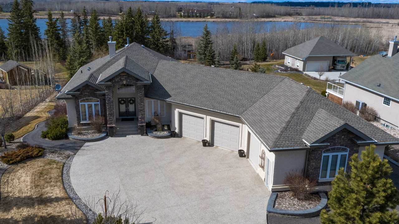You will appreciate having the perks of country living with the amenities of city life. Hard to believe you?re only about 25 minutes from downtown! Instant first impression - the sky-high ceilings extend all the way back to an enormous window that gives you a spectacular view. Your glorious acre backs right onto the lake with sunset views all summer long. Your land is meticulously landscaped with impeccable detail, making it the perfect place to entertain this summer. Inside, little details will consistently impress. Every single part of your home has been upgraded and enhanced to a true luxury spec. Unwind in your master suite, complete with a handcrafted custom built walk in closet. Downstairs, the 2 bedrooms are perfect for young teens to university aged kids. They will love hanging out in their ultimate entertainment room. Finally, gentleman: the shop. 220v wiring throughout. Woodworking, cars, you name it. Book a viewing, you definitely have to see it in person.
