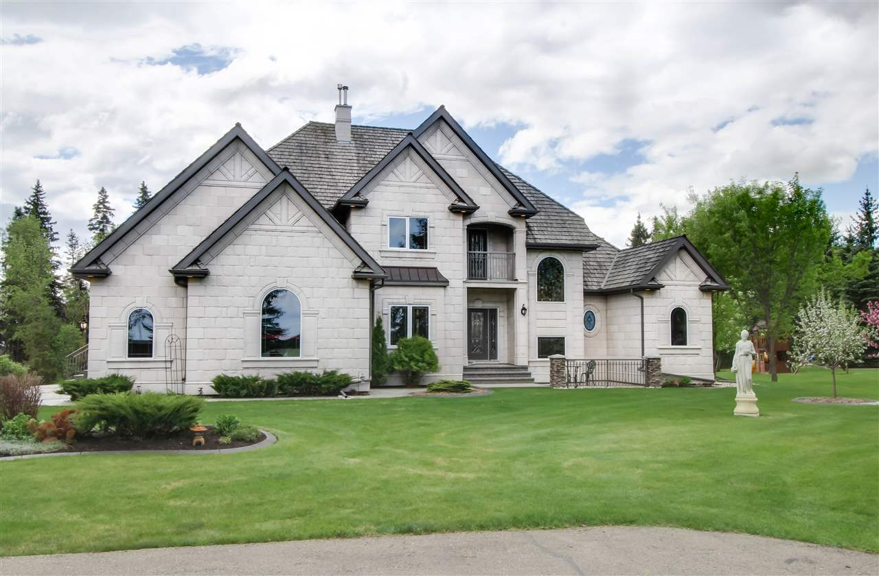 Looking for an exclusive executive acreage backing a picturesque ravine and only minutes from Spruce Grove? This gorgeous custom built 3 bed 2.5 bath two storey home features over 2,700sqft of developed living space and boasts soaring vaulted ceilings with an open to below design that frames the stunning backyard and creek lined ravine perfectly. No expense has been spared to create this luxury home and high end finishings and meticulous attention to detail can been seen throughout. Upgrades such as pristine hardwood floors, ceramic tile, wrought iron railings, central A/C, 2 newer high eff. furnaces w/ HRV's, U/V air purifier, undev. walkout basement, elegant stone tile exterior framed with a classic roof line topped off w/ cedar shakes, 3 decks, exposed aggregate with stamped concrete detail, 24x26 heated garage, quick curb, and over $35k invested in the backyard creek and fire pit area for family gatherings. This home will exceed Your expectations and truly must be seen to be appreciated.