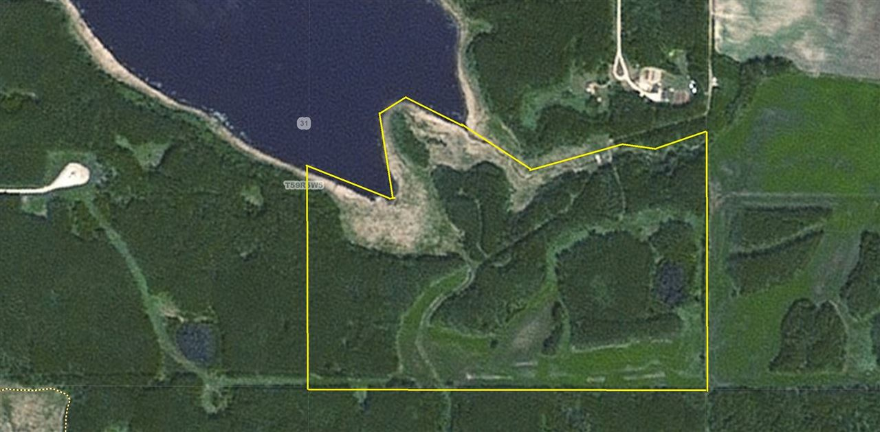 106 Acres TIGER LAKE FRONTAGE bordering and over looking this scenic shallow body lake along with unique feature of backing onto Thunder Lake Provincial Park to it's south  Property located only 14 miles west of Barrhead just off pavement. Excellent property for recreational activities such as quadding, skidoo-ing and camping. 66+ acres of natural Bush with 40 acres currently in Hay and Pasture. Complete the County road allowance to property for an unbelievable building site with lake views and crown recreation land behind. CONSIDERING ALL OFFERS AND TRADES !!!