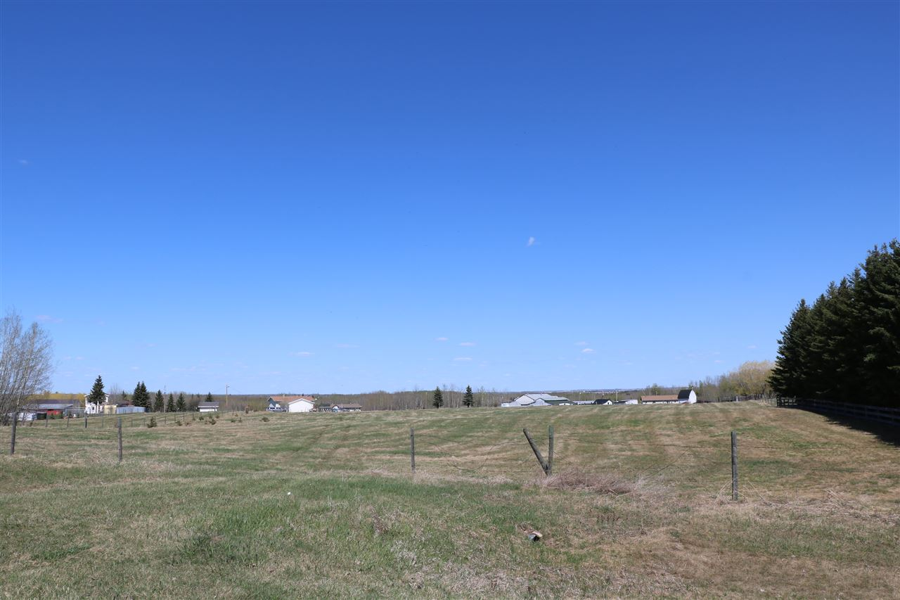 Build your dream home on over 3 fenced acres on PAVEMENT and close to Stony Plain and Golf Courses. Nice flat site in the subdivision of Glory Hills. Services to the property line. Priced is Well below county appraised value.