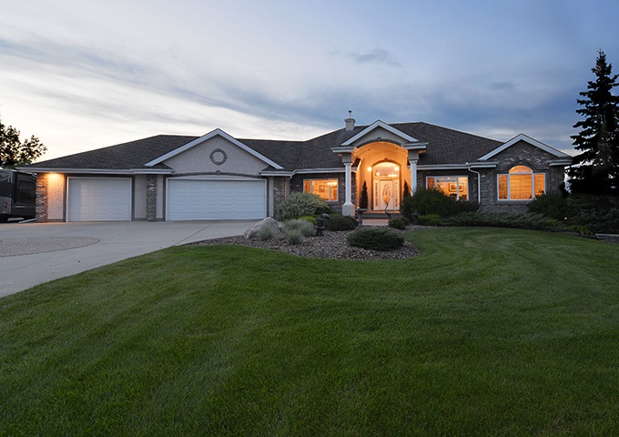 Beautiful  walk-out bungalow in Shadow Ridge Estates! Located in a quiet cul-de-sac 5 MINUTES East of Sherwood Park, this 2,940 sq.ft. home is nestled on to 2.03 beautifully landscaped acres and boasts an abundance of natural light from floor-to-ceiling windows, custom built-in cabinets, and an open floor plan. The large chef?s kitchen features an island with breakfast bar, Stainless Steel appliances, breakfast nook, and French doors to a relaxing sunroom with access to the back deck with North, East & West exposure. Adding to the convenience of main floor living are a spacious master bedroom with 5-piece ensuite, 2nd bedroom, formal dining room and private den. Descend the curved staircase to the fully finished walk-out lower level, complete with a large games area, custom wet bar, family room with fireplace, 2 additional bedrooms, 4-piece bath, and 2nd kitchen. Additional features include mature trees, RV parking, attached 3-car heated garage, and a single garden tractor garage. This home MUST BE SEEN!