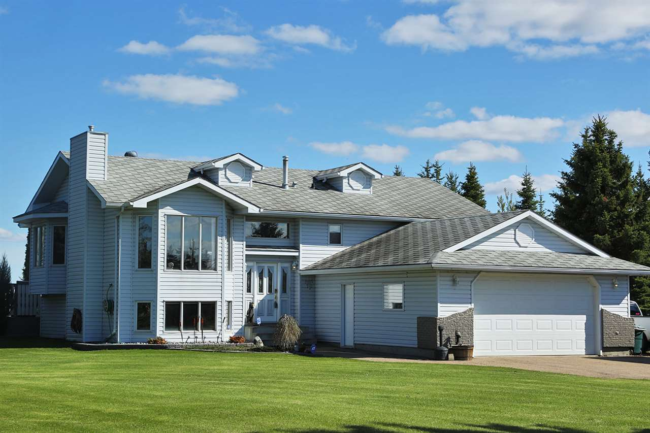 Location! Location! Well situated beautiful acreage that is only minutes to Redwater/Gibbons/Fort Saskatchewan and Edmonton! This gorgeous 5 Bedroom Air conditioned home has had upgrades that include a high efficiency furnace, Oak Harwood floors, water heaters(2), hot tub and deck. The large multi-level deck includes a hot tub, fire pit and deck furniture, ready for family gatherings! The 1.47 Acre lot includes mature trees , 2 storage sheds , RV parking area, garden area and an attached 24'x 24' garage. The Riverside Park acreages are connected to city water and are sought after properties, a must see!