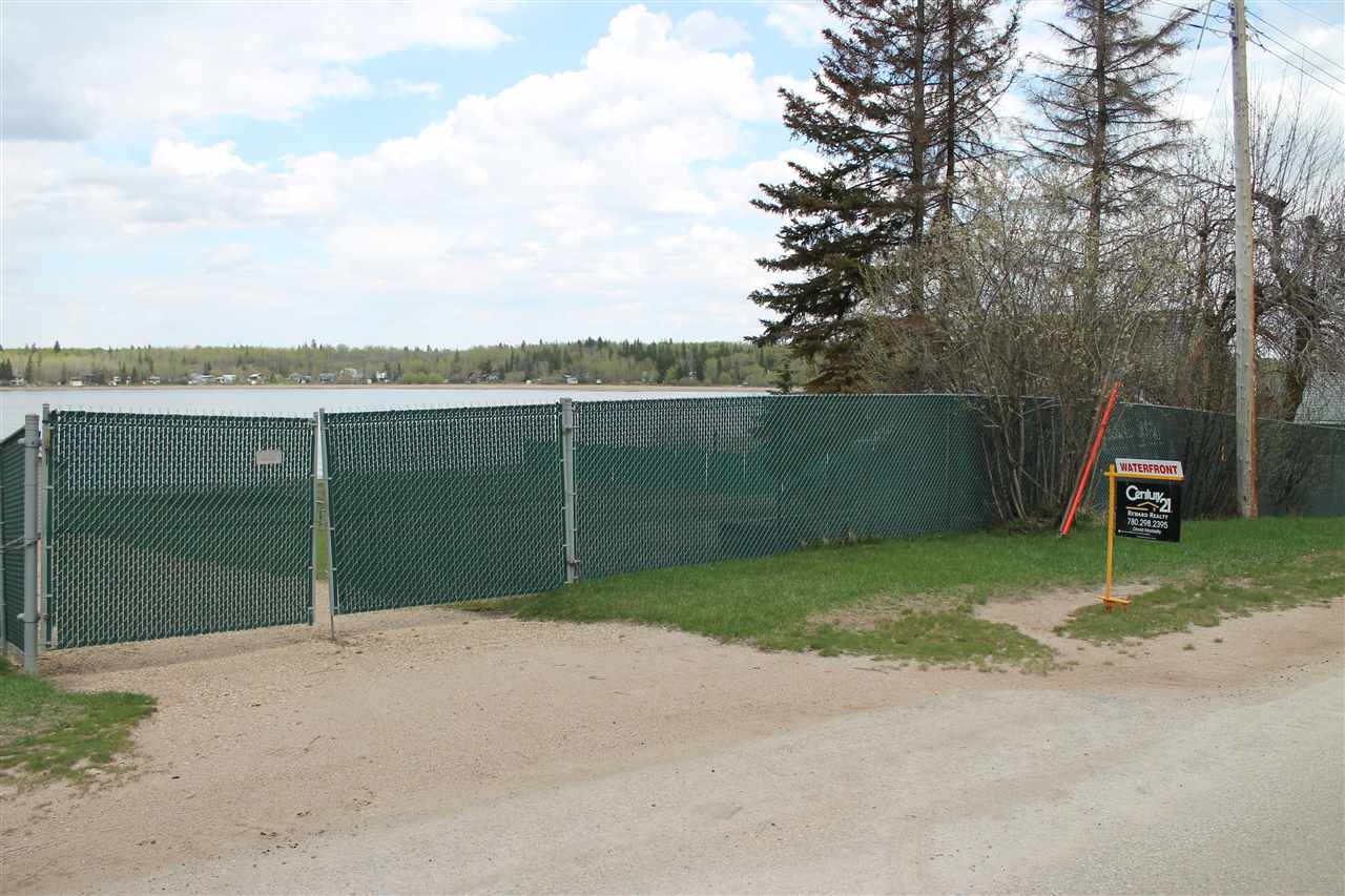 LAKEFRONT LOT in Sandy Beach! One of the nicest lots in the Area w/ Sandy Beach Front and Retaining wall at the edge of the Beach & a Gated Driveway! Perfect Spot to Build your Weekend Get Away on 30mins from Edmonton! Paved Highways to the Property! Approx 50' of Frontage. Lot Next Door (458 Lakeview) is also for sale.
