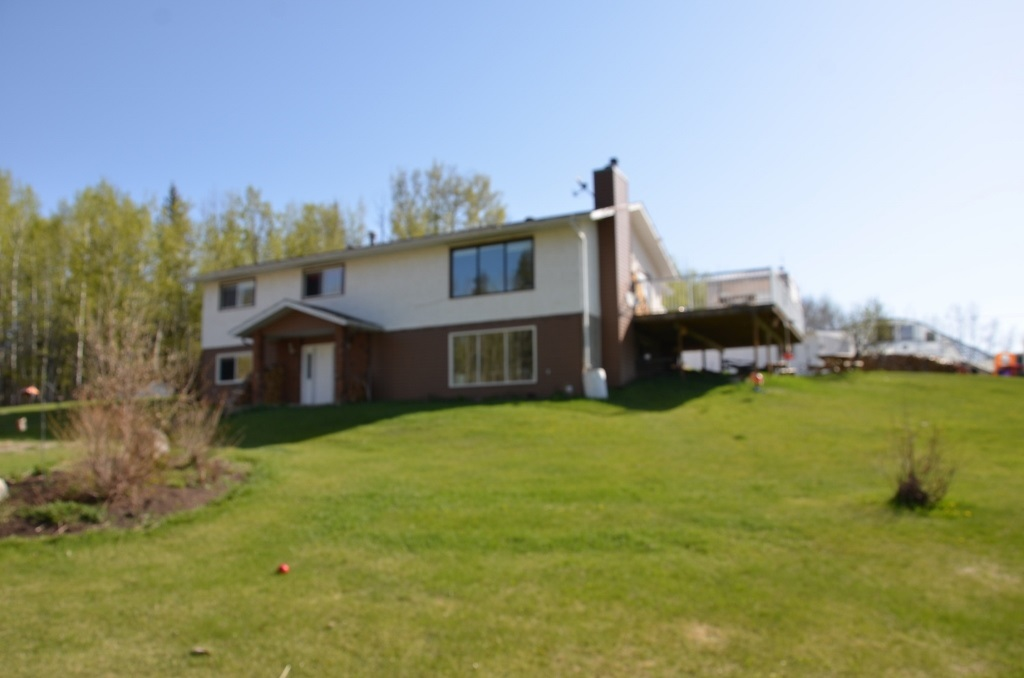 Secluded 6 acre estate. located 10 miles West of Barrhead with high grade roads to property line. (No gravel). 1446 sq ft Bungalow with fully finished walkout basement. Restyles and reconstructed with modern design. New colors, floors, lighting, trims and more. 3 plus 1 bedromms and 3 fully revamped baths. Opened living, dining and kitchen area. Large island, abundant cabinet space and stainless appliances. Spacious basement family room features wood fireplace and large windows. Gigantic new deck with overlooking views of maturely landscaped yard site and surrounding reserve land bordering property. Abundant wildlife at your door step. Nice over sized garage with 2 car bays and extra R.V storage. 16'x24' heated workshop. 2 storage sheds. Large commercial greenhouse frame makes perfect winter hockey rink. Open dugout water supply. Sheltered fire pit area. Great feel and atmosphere ready and awaiting you