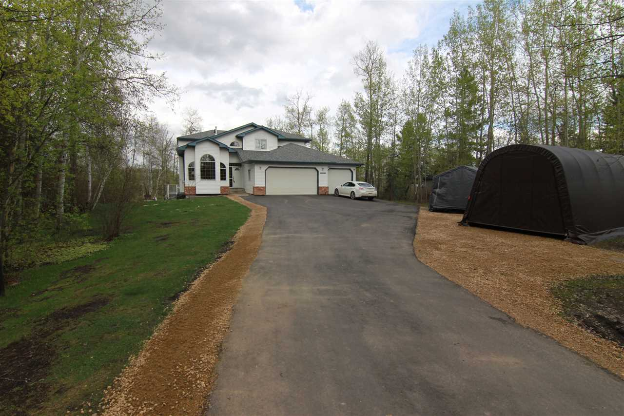 This is a DREAM lifestyle! Imagine LAKE LIVING just minutes from town. This 1 acre lot is LAKE FRONT at Half Moon Lake Estates. Come home from work and go for a swim or boat ride! In winter enjoy skating and ice hockey! Spectacular setting with gorgeous views! Almost 2300 sqft WALKOUT 2 storey is move in ready! The main floor has a formal living and dining room with VAULTED CEILINGS. The kitchen has an abundance of storage and s/s appliances. There is a spacious breakfast nook which leads to the great room. The great room has a wood burning fireplace and 2 storey ceiling with loads of windows taking in the amazing LAKE VIEW. Just off the great room is a main floor den with French doors. Completing the main floor is a 3pce bath, and laundry. Upstairs there are 3 bedroom and a main 4pce bath. The master bedroom has a walk in closet and 4pce ensuite. The fully finished WALK OUT basement has a large family room, 4th bedroom, 3 pce bath. Central A/C, Newer FURNACE. TRIPLE attached garage.